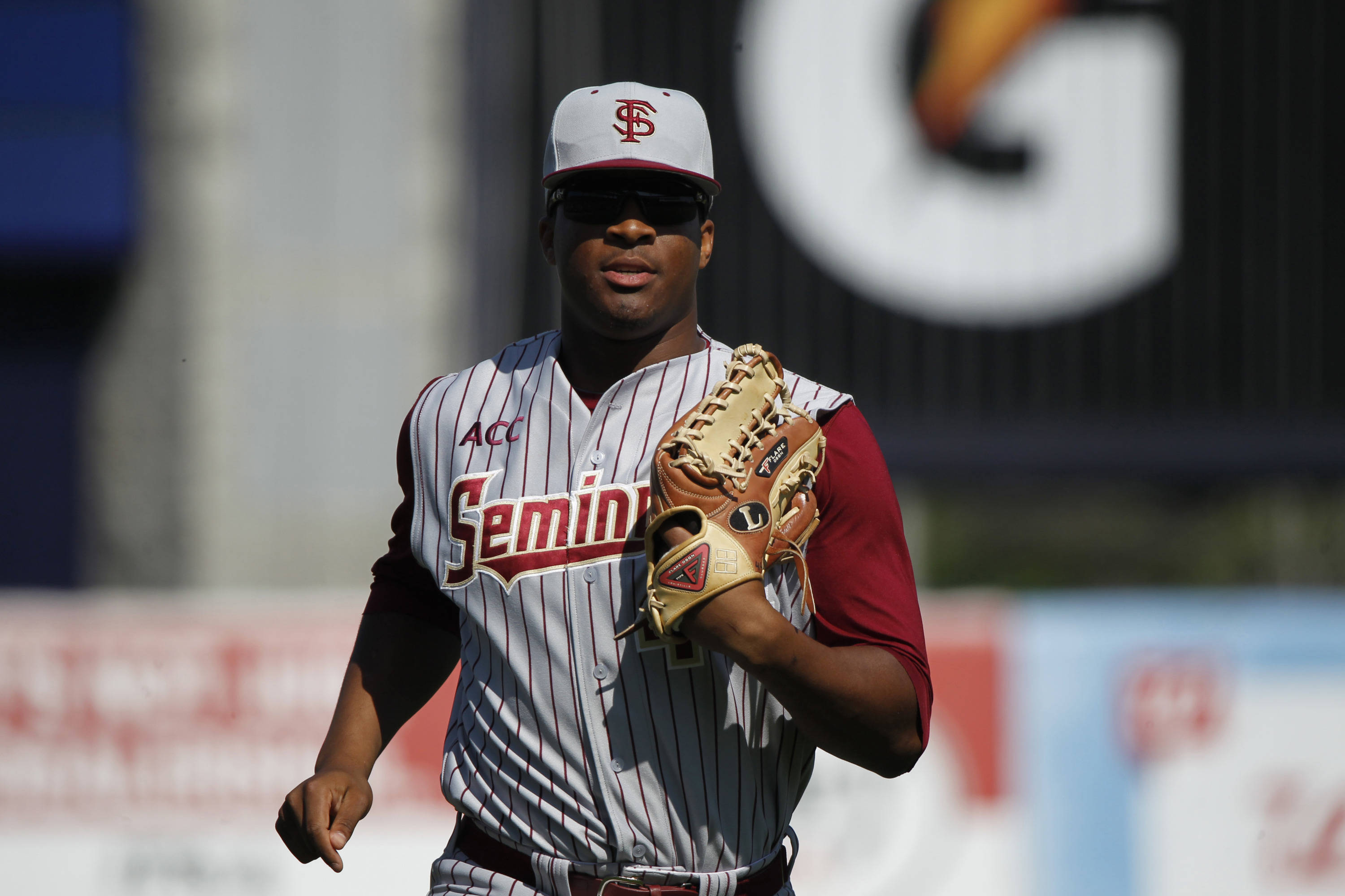 Feb 25, 2014; Tampa, FL, USA;  Florida State Seminoles pitcher/outfielder Jameis Winston (44) runs back to the dugout during the fifth inning against the New York Yankees at George M. Steinbrenner Field. Mandatory Credit: Kim Klement-USA TODAY Sports