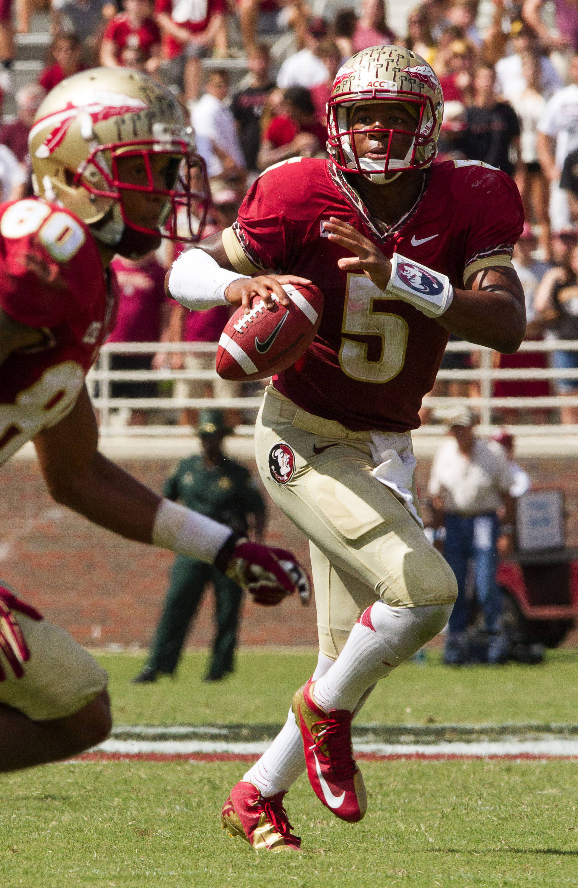 Jameis Winston (5) drops back to pass during FSU Football's 63-0 shutout of Maryland on Saturday, October 5, 2013 in Tallahassee, Fla.