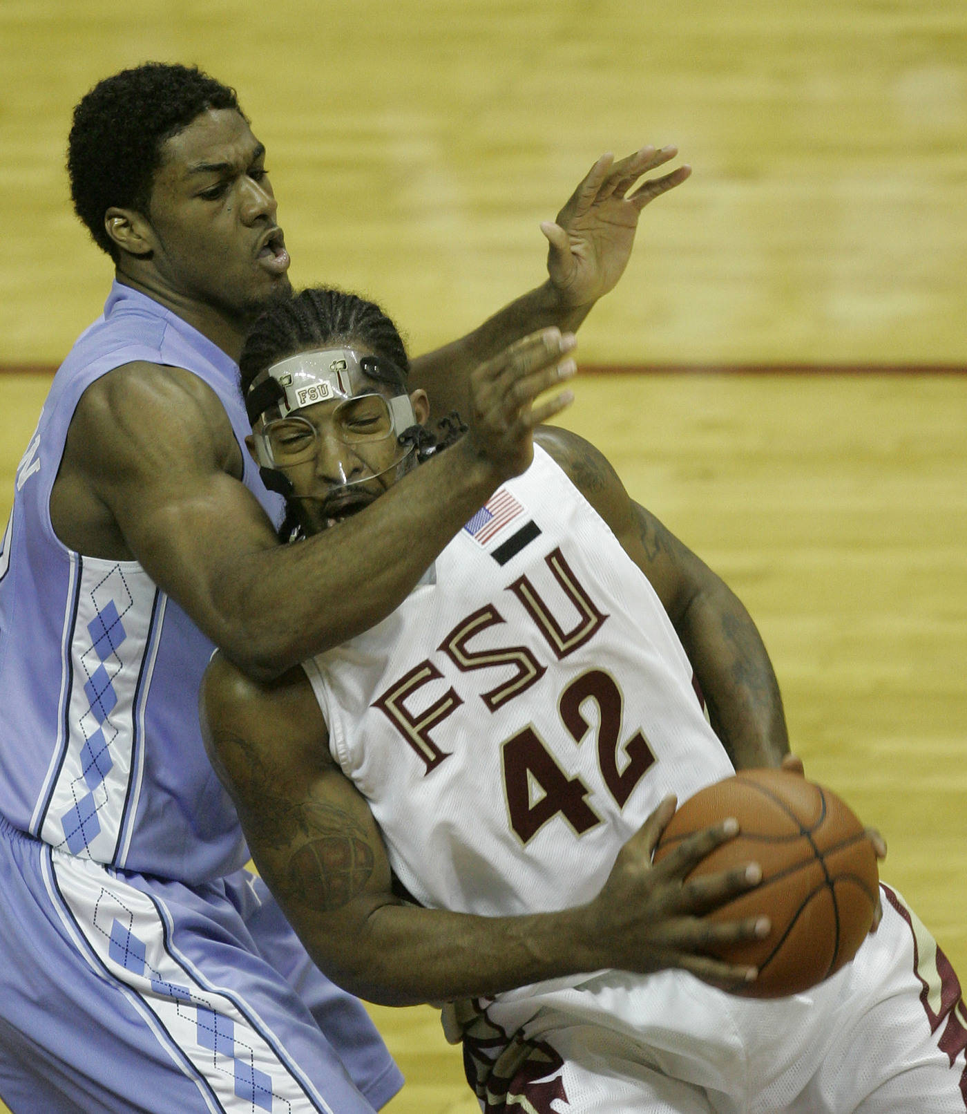 Florida State's Ryan Reid, right, is fouled by North Carolina's Alex Stephenson during the first half (AP Photo)