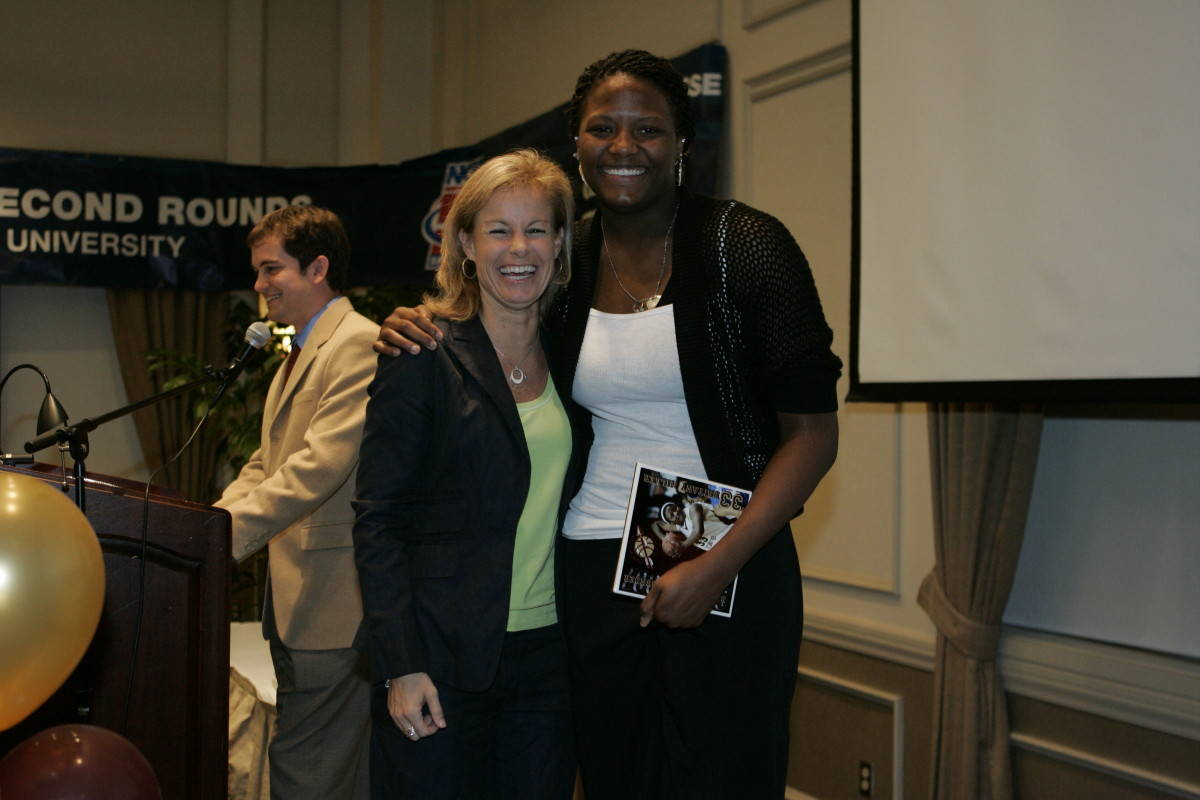 Coach Sue and Britany Miller, the Relentless Rebounder Award recipient