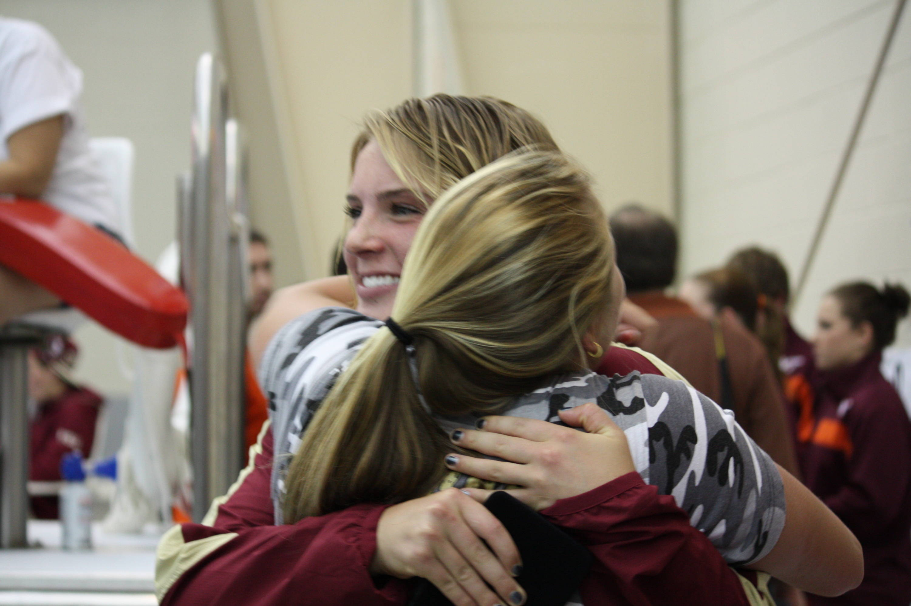 Junior Ariel Rittenhouse congratulates Katrina Young after she's awarded the gold medal.