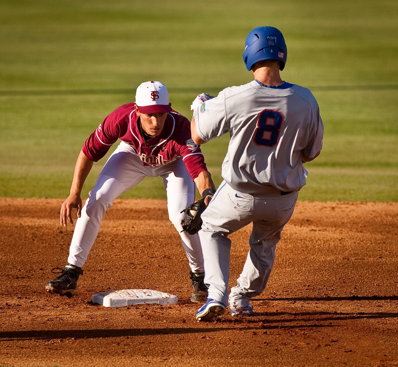 Justin Gonzalez (10) tags out Daniel Pigott at 2nd base