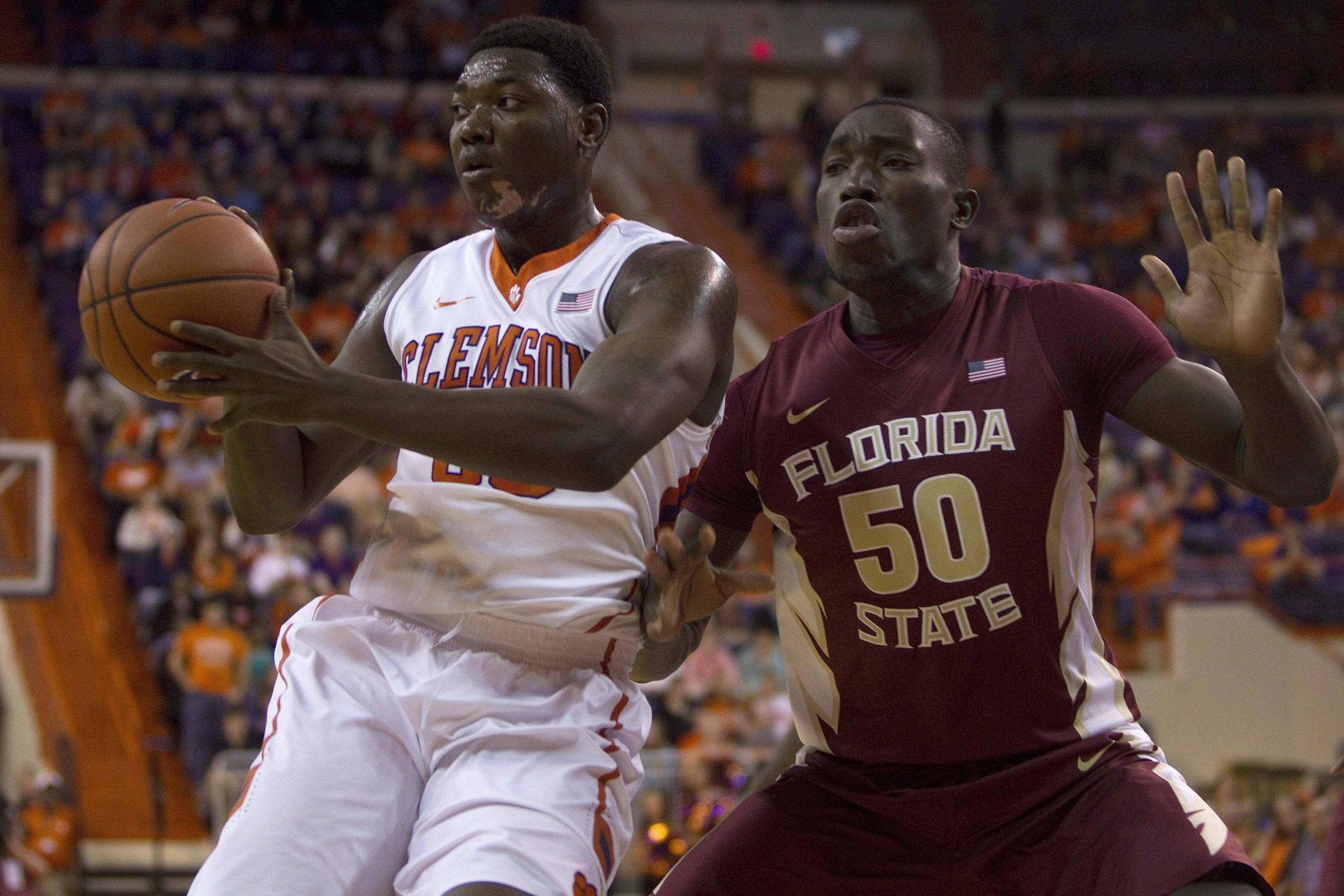 Jan 9, 2014; Clemson, SC, USA; Clemson Tigers forward/center Josh Smith (33) drives to the basket while being defended by Florida State Seminoles center Michael Ojo (50) during the first half at J.C. Littlejohn Coliseum. Mandatory Credit: Joshua S. Kelly-USA TODAY Sports