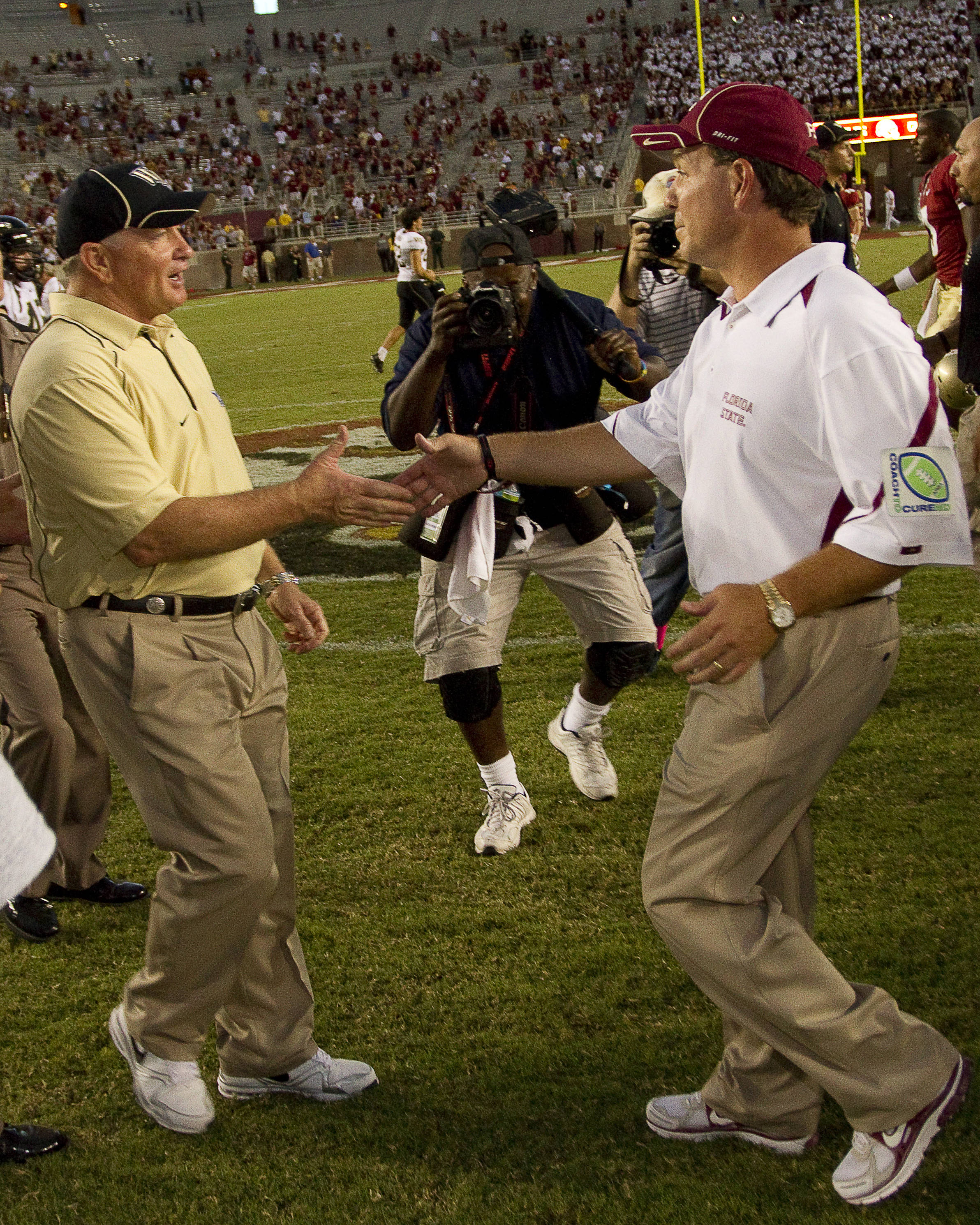 Jimbo Fisher shakes hands with Wake Forest's head coach Jim Grobe.