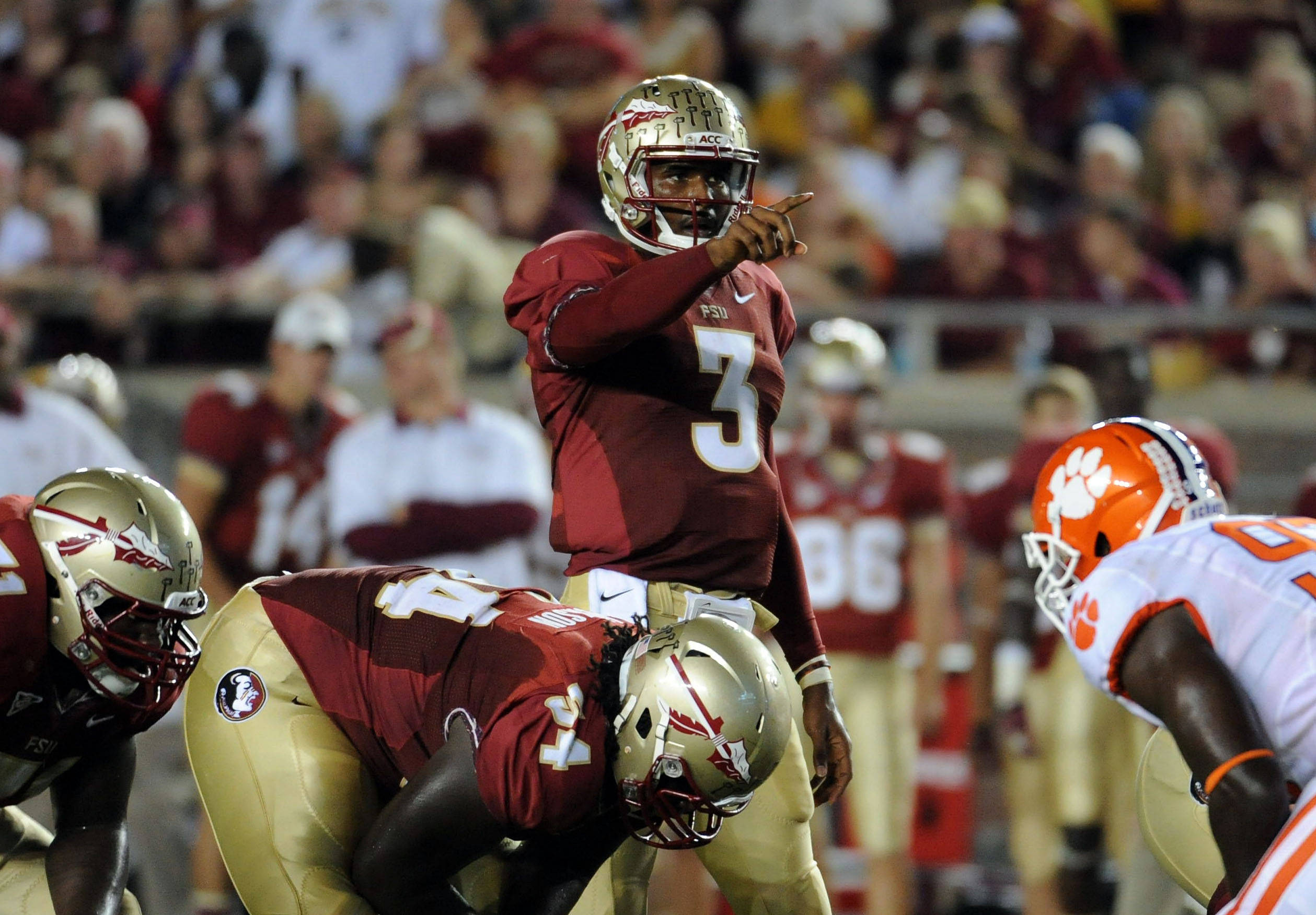 Sept 22, 2012;  Tallahassee, Florida, USA; Florida State Seminoles quarterback E.J. Manuel (3) gestures at the line of scrimmage during the first half of the game against the Clemson Tigers at Doak Campbell Stadium. Mandatory Credit: Melina Vastola-USA TODAY Sports