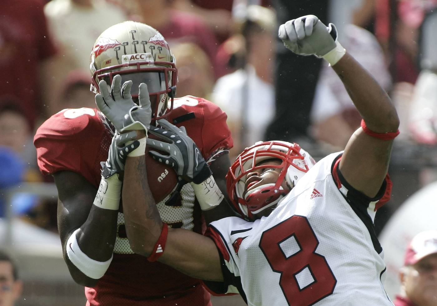 Florida State receiver Greg Carr, left, makes a first quarter catch as North Carolina State's Jimmie Sutton, right, attempts to defend. (AP Photo/Phil Coale)
