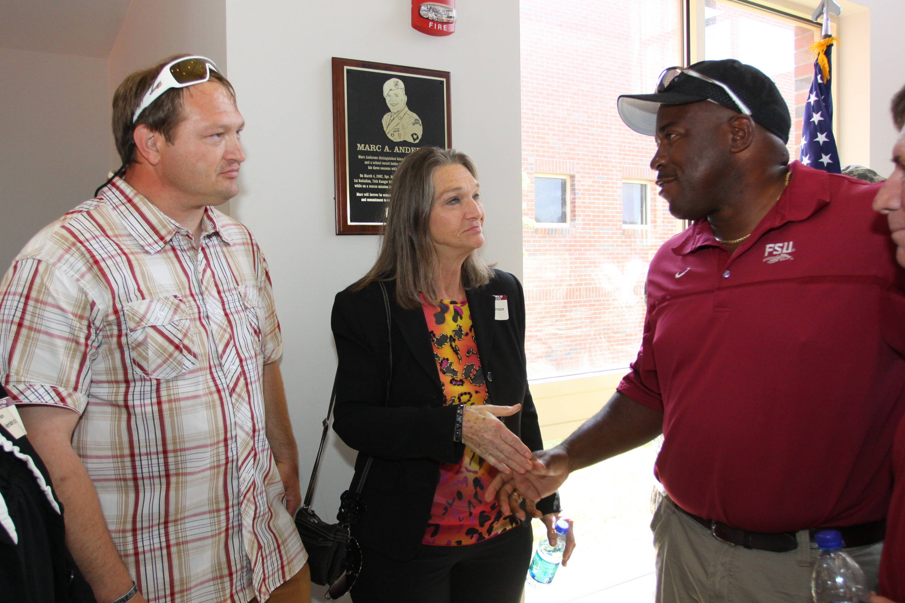 FSU Associate Head Coach Harlis Meaders, who was Marc Anderson's throws coach during the 1995 season with the Seminoles, greets Judy Anderson and John Anderson.