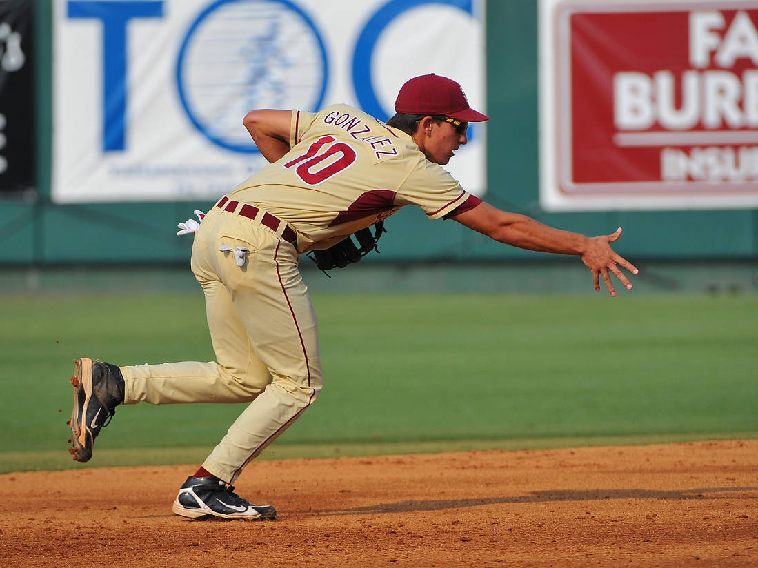 Shortstop Justin Gonzalez flips the ball toward second base for a force out in the early going against Texas A&M.