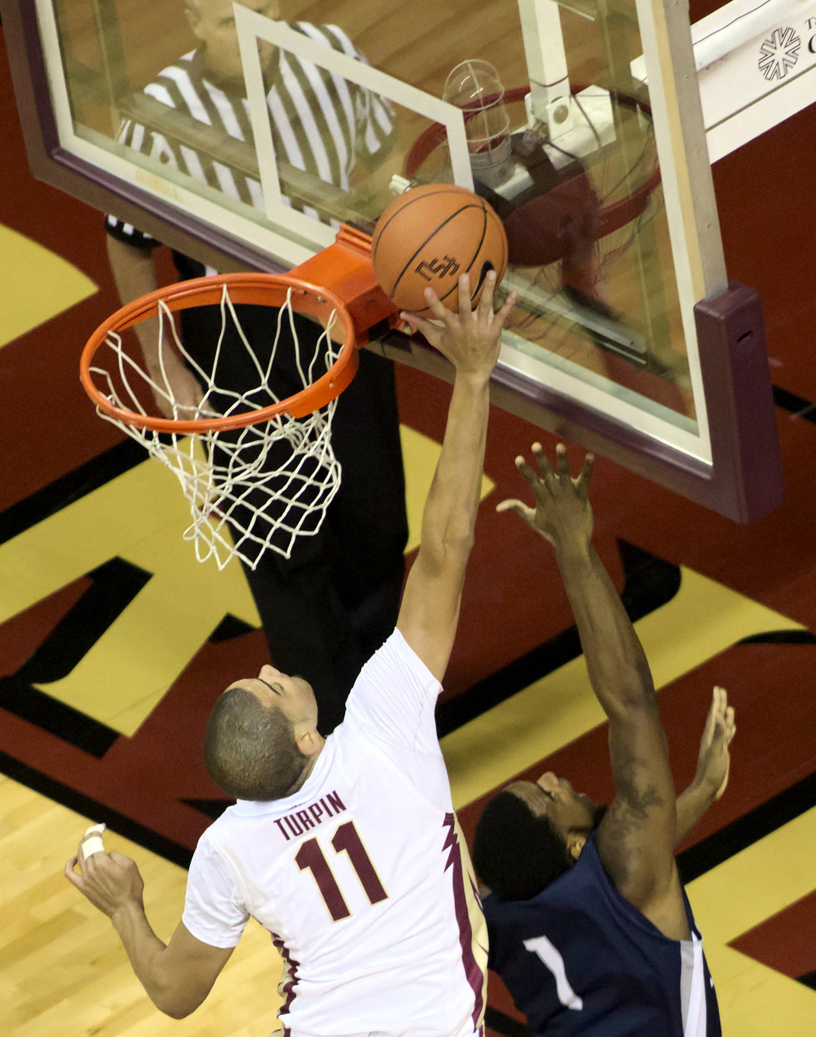 Kiel Turpin (11), FSU vs No. Fla, 11/21/12. (Photo by Steve Musco)