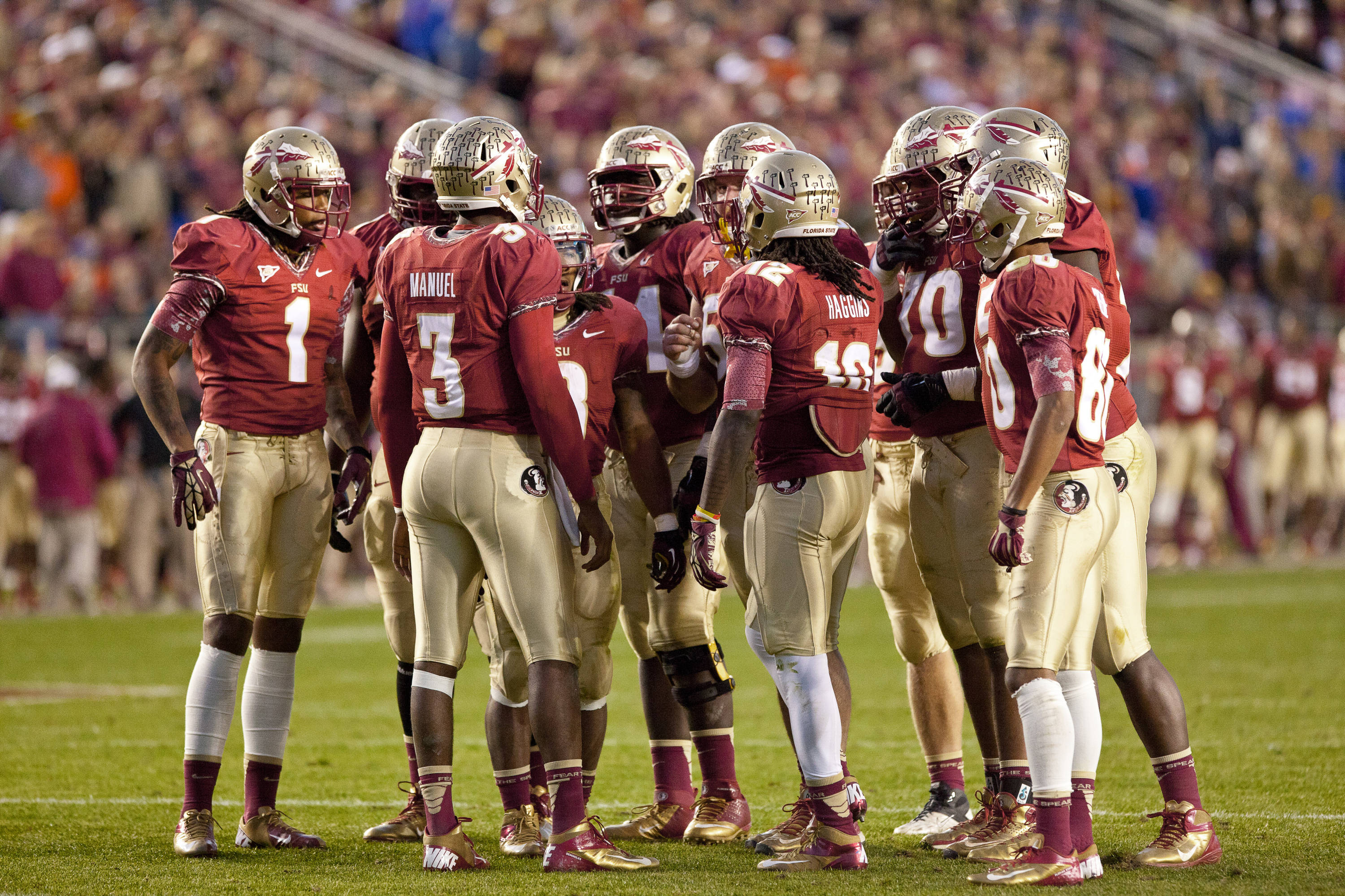 The 'Noles huddle during FSU Football's game against UF on Saturday, November 24, 2012 in Tallahassee, Fla.