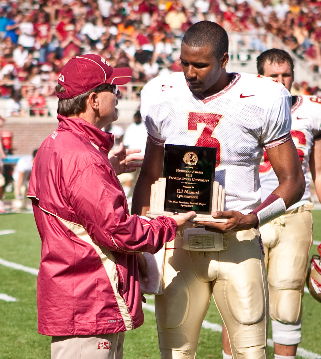 Jimbo Fisher awards EJ Manuel (3) the Hinesman Award as the overall MVP of the spring