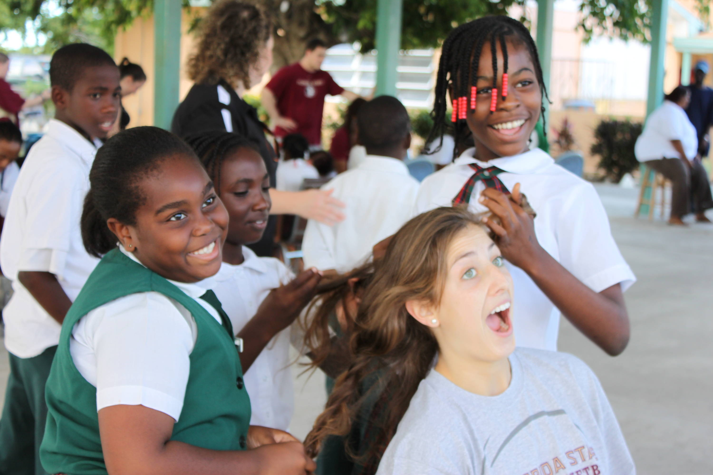 After getting their new shoes, some of the students wanted to braid Leonor Rodriguez's hair.