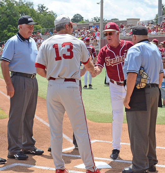 FSU head coach Mike Martine meets Indiana head coach Tracy Smith at home plate before the start of Saturday's game.
