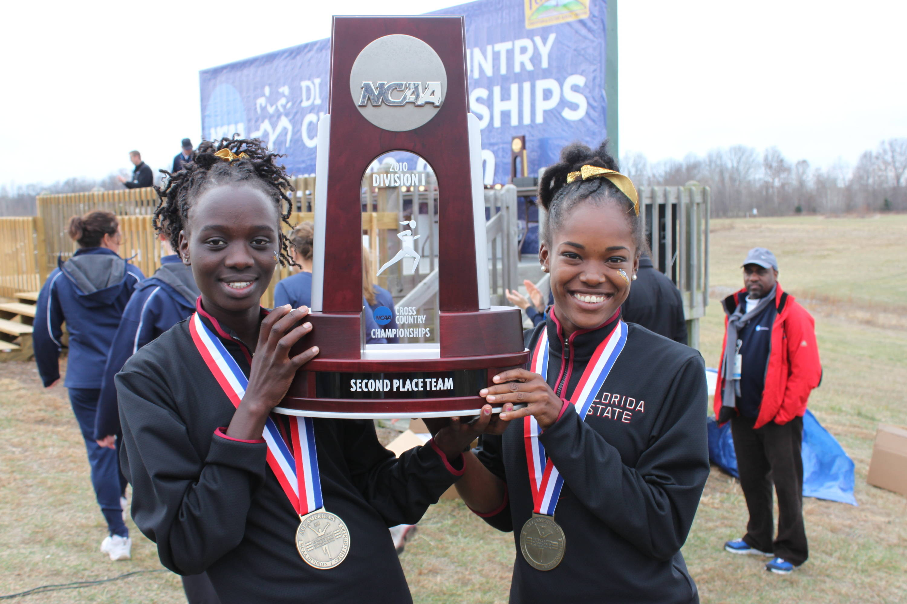 Seminole seniors Pasca Cheruiyot and Pilar McShine celebrate after closing their careers in fine fashion.