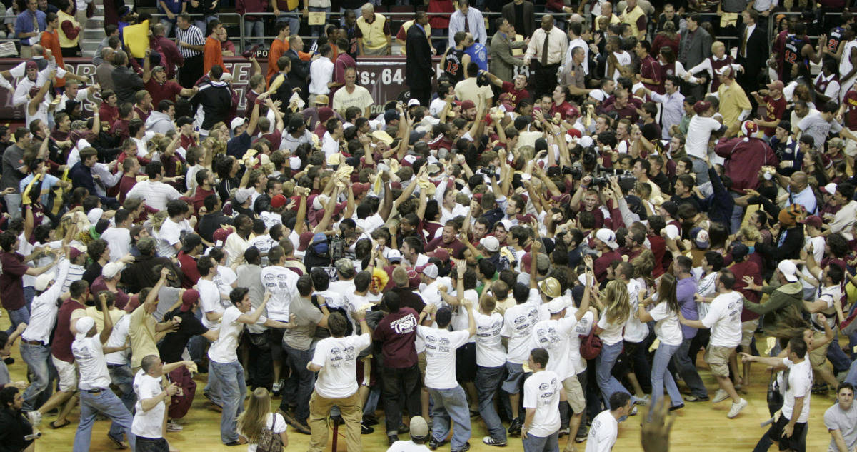 Florida State fans storm the court following the Seminoles 70-66 upset win over the Florida Gators, Sunday, Dec. 3, 2006, in Tallahassee, Fla.(AP Photo/Phil Coale)