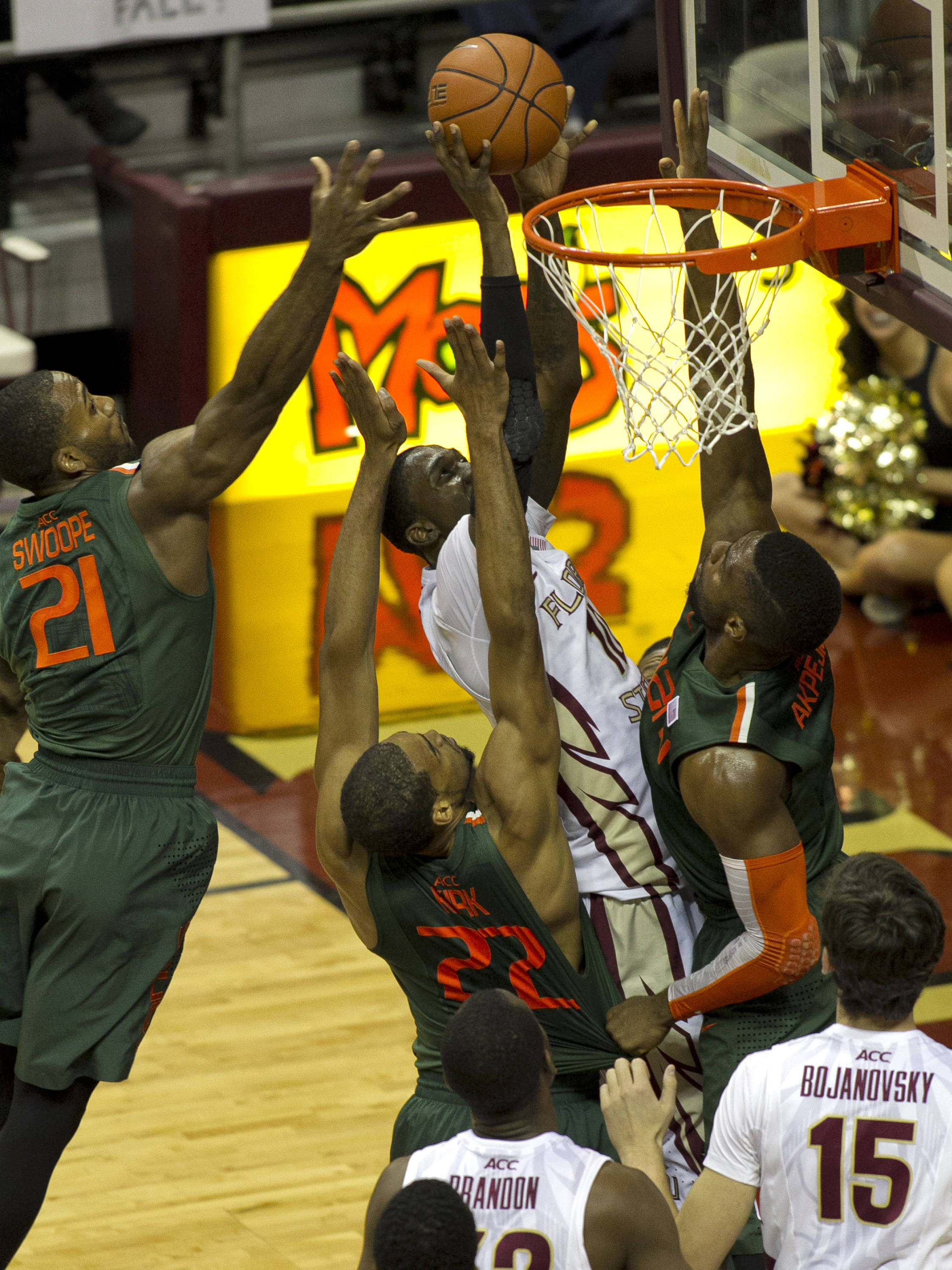 Okaro White (10) battles for a layup, FSU vs Miami, 2-10-14, (Photo's by Steve Musco)