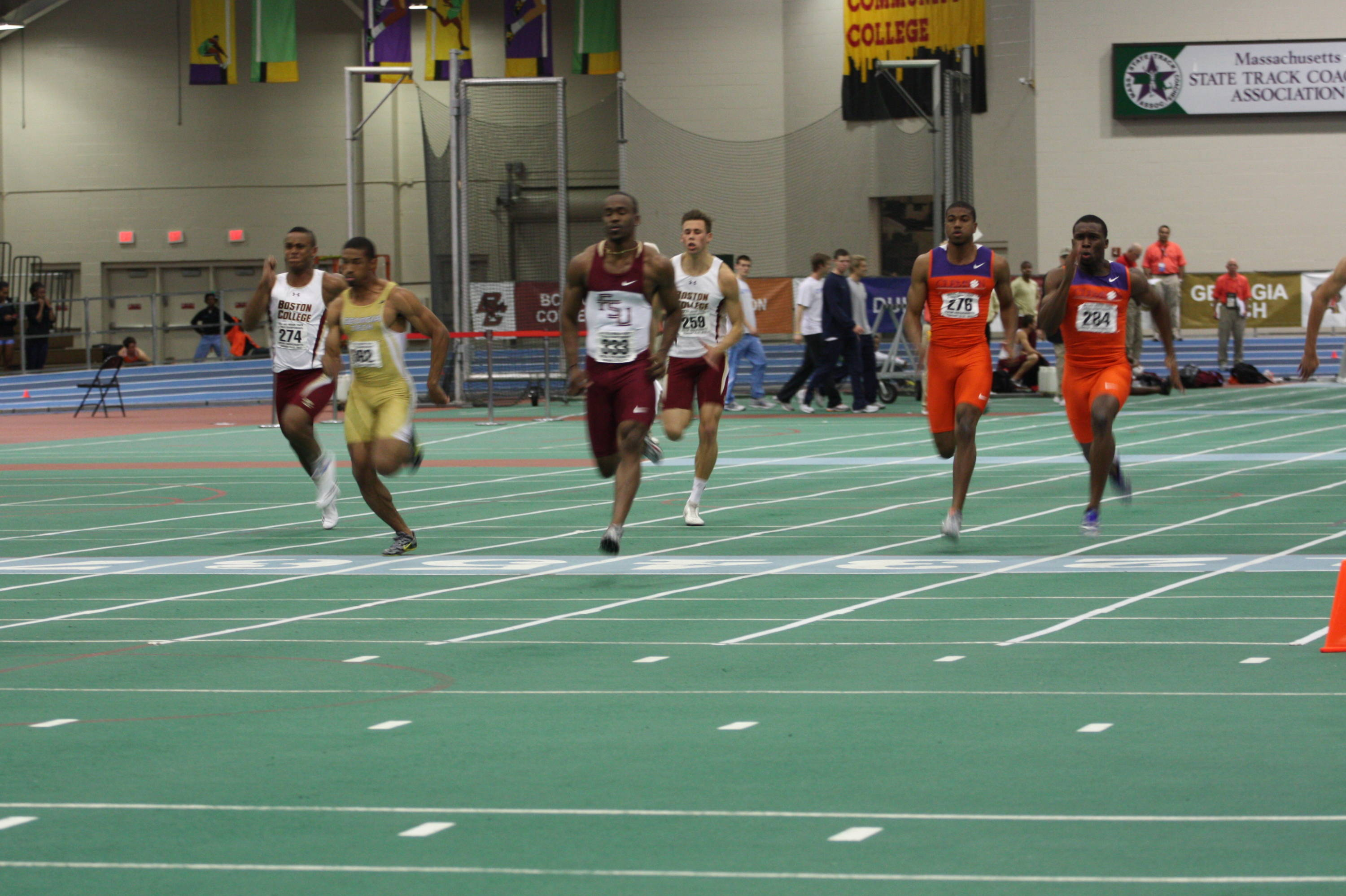 Kemar Hyman (center) cruises to the top qualifying time - 6.60 - in the 60-meter dash.