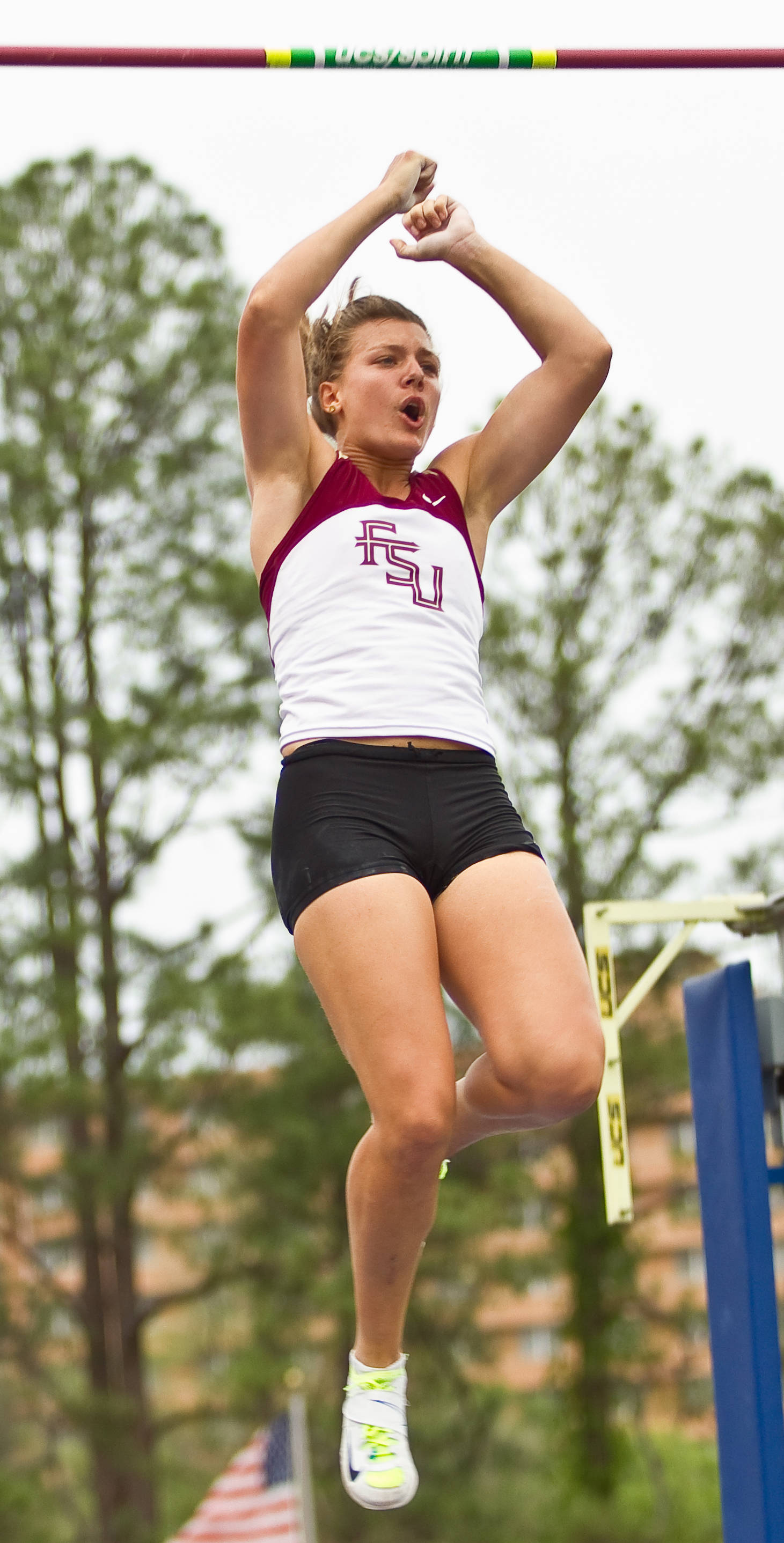 Lauren Giffin celebrates a clearance in the pole vaults