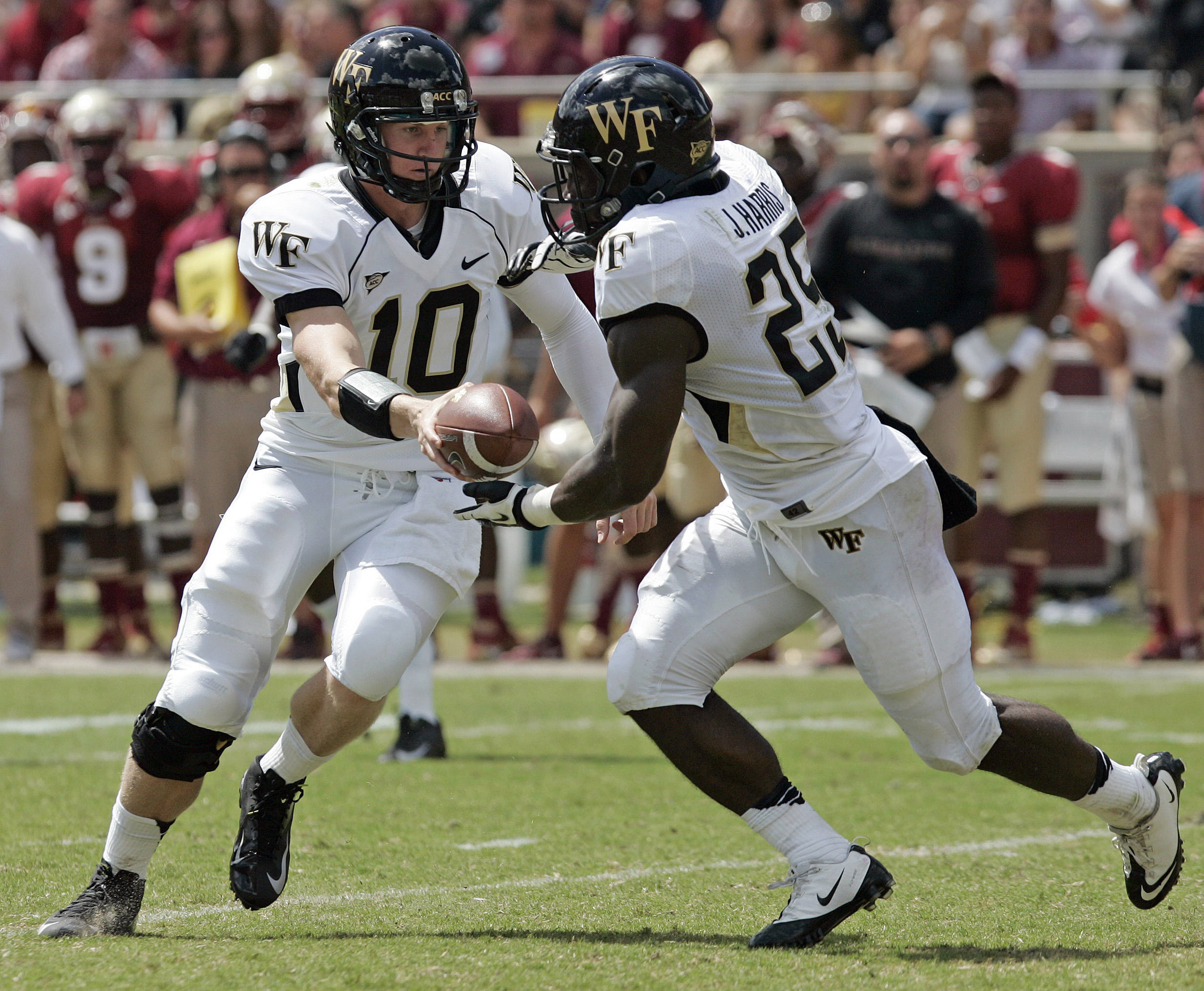 Wake Forest's quarterback Tanner Price, left, hands off to running back Josh Harris as they try to run against Florida State. (AP Photo/Steve Cannon)