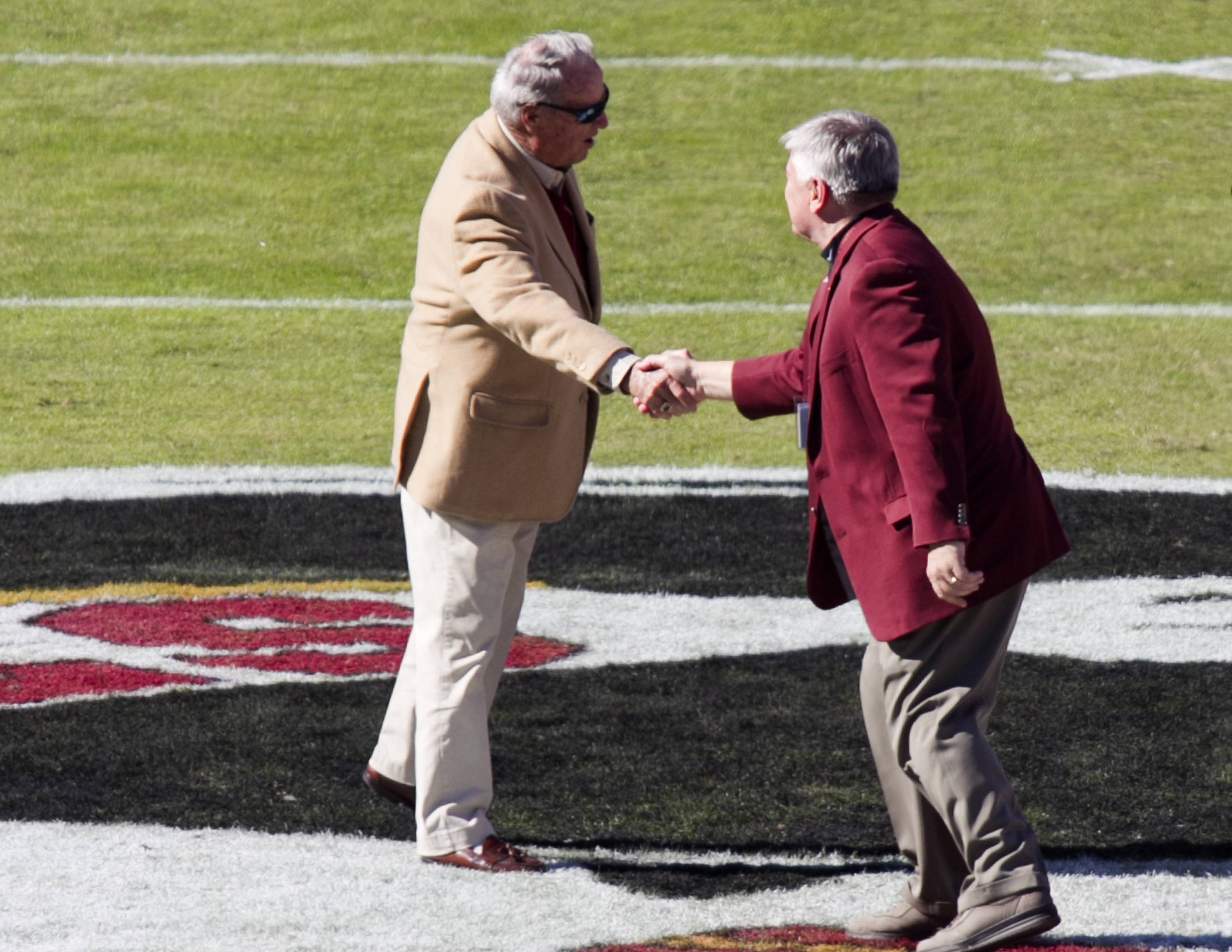 Welcome back handshake, FSU vs NC State,  10-26-13, (Photo by Steve Musco)