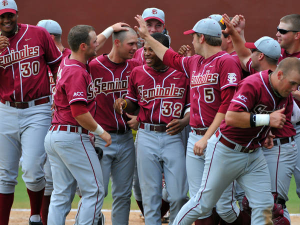 The Seminoles celebrate after Mike McGee's home run.