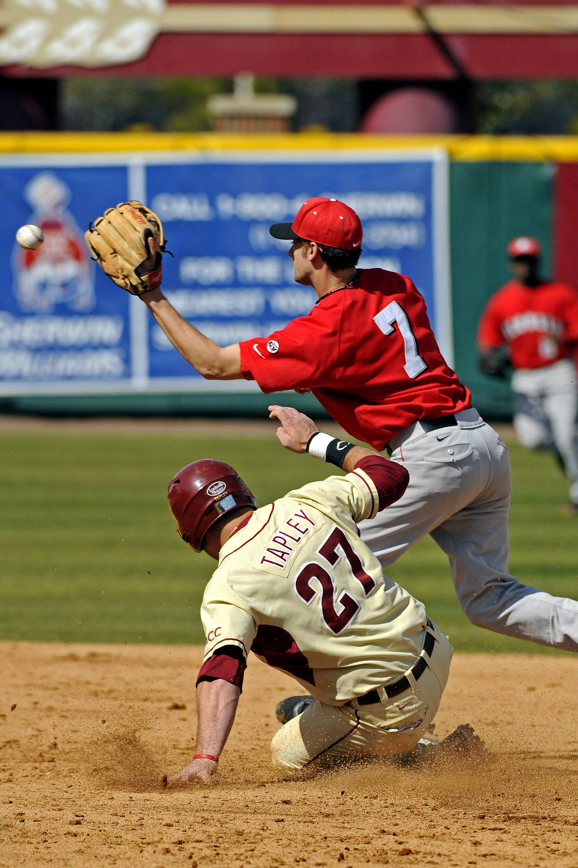 Stuart Tapley slides in at second base.