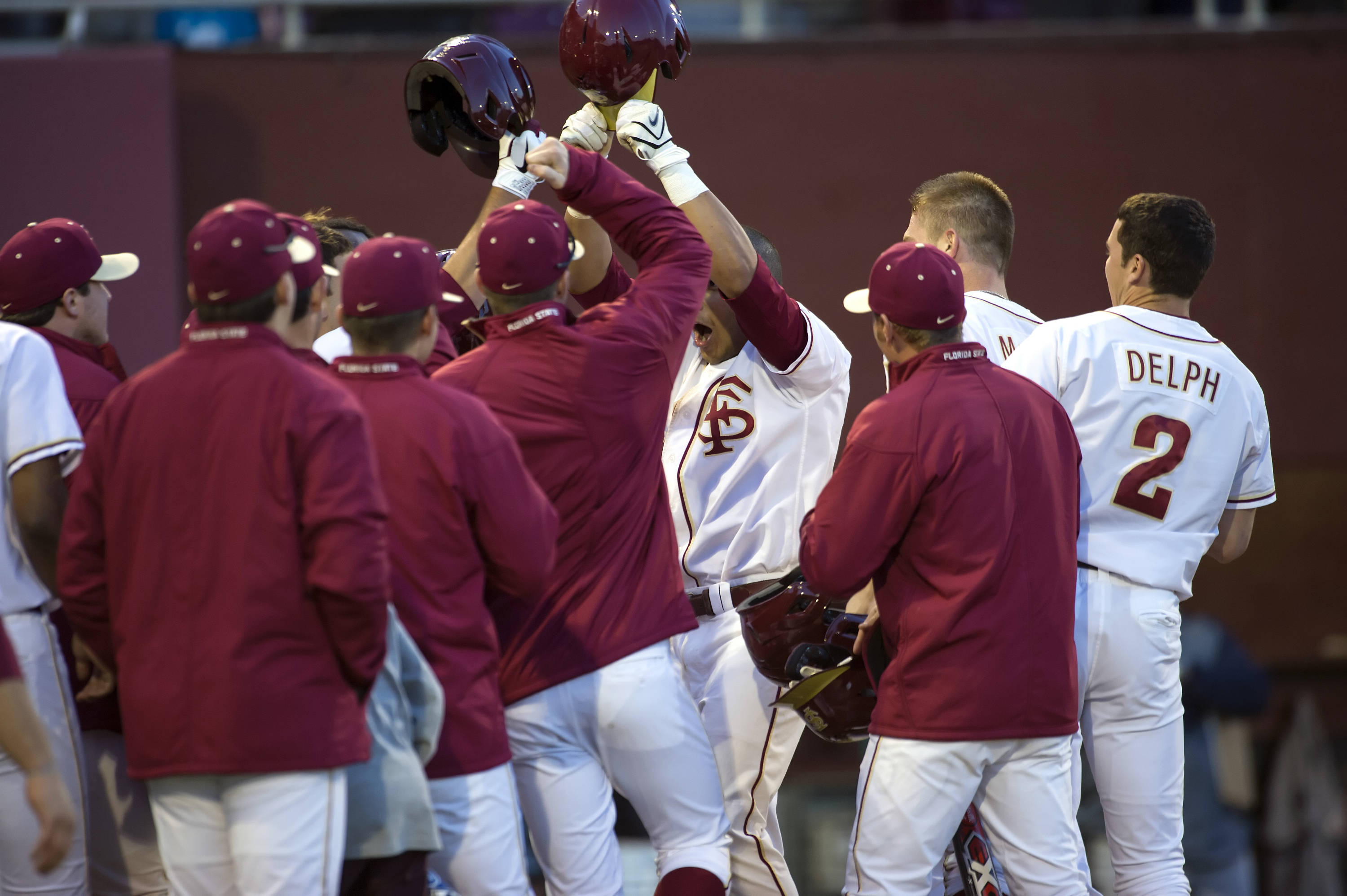 The Seminoles celebrate at the plate after Jose Brizuela's sixth inning grand slam.