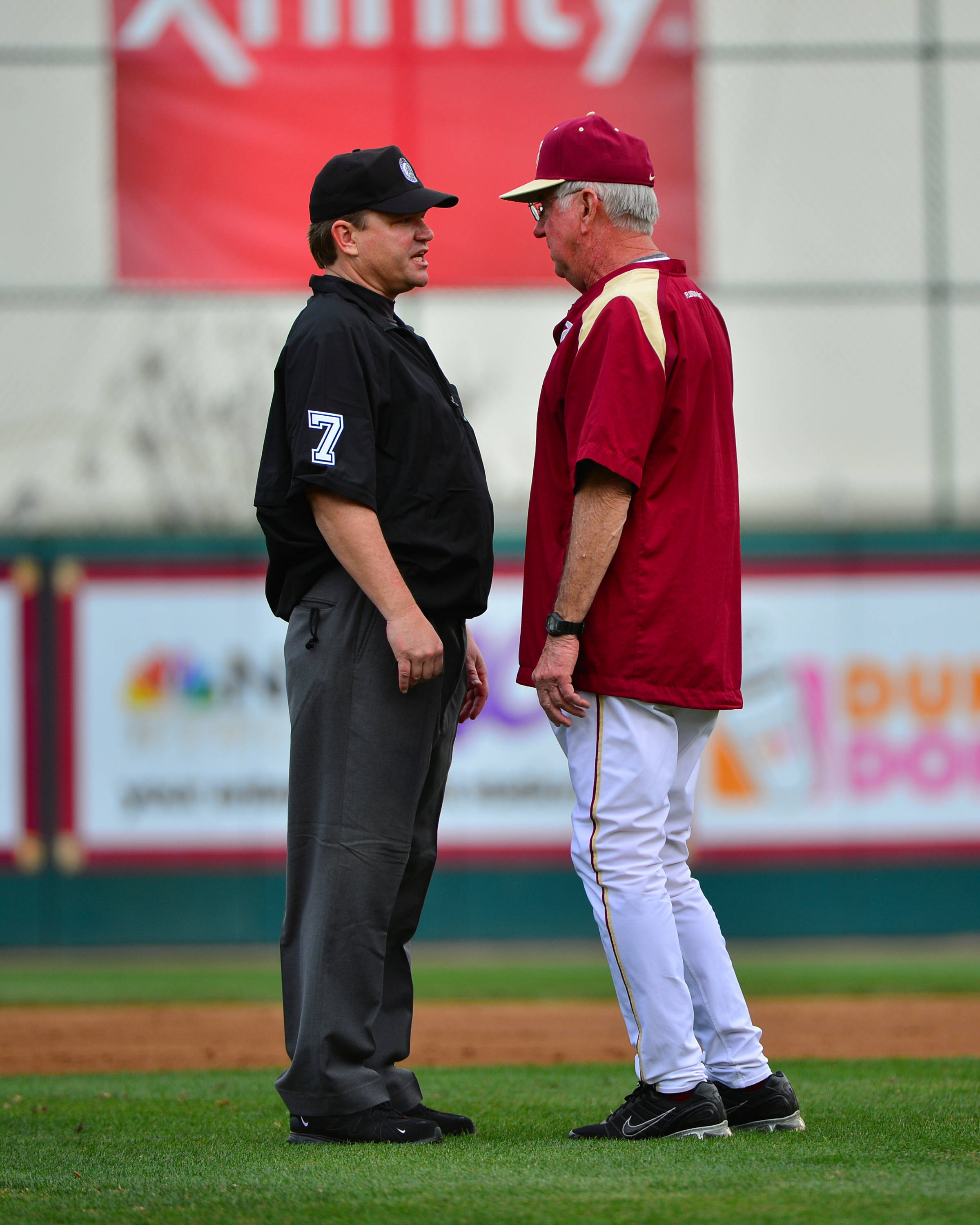 Head coach Mike Martin asks about a call during the game.