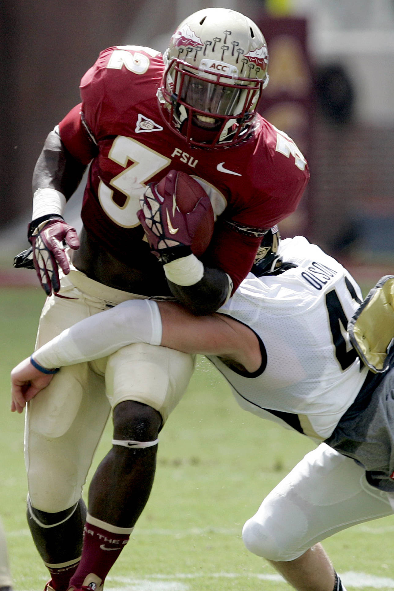 Florida State's James Wilder Jr. is tackled by Wake Forest's Mike Olson. (AP Photo/Steve Cannon)