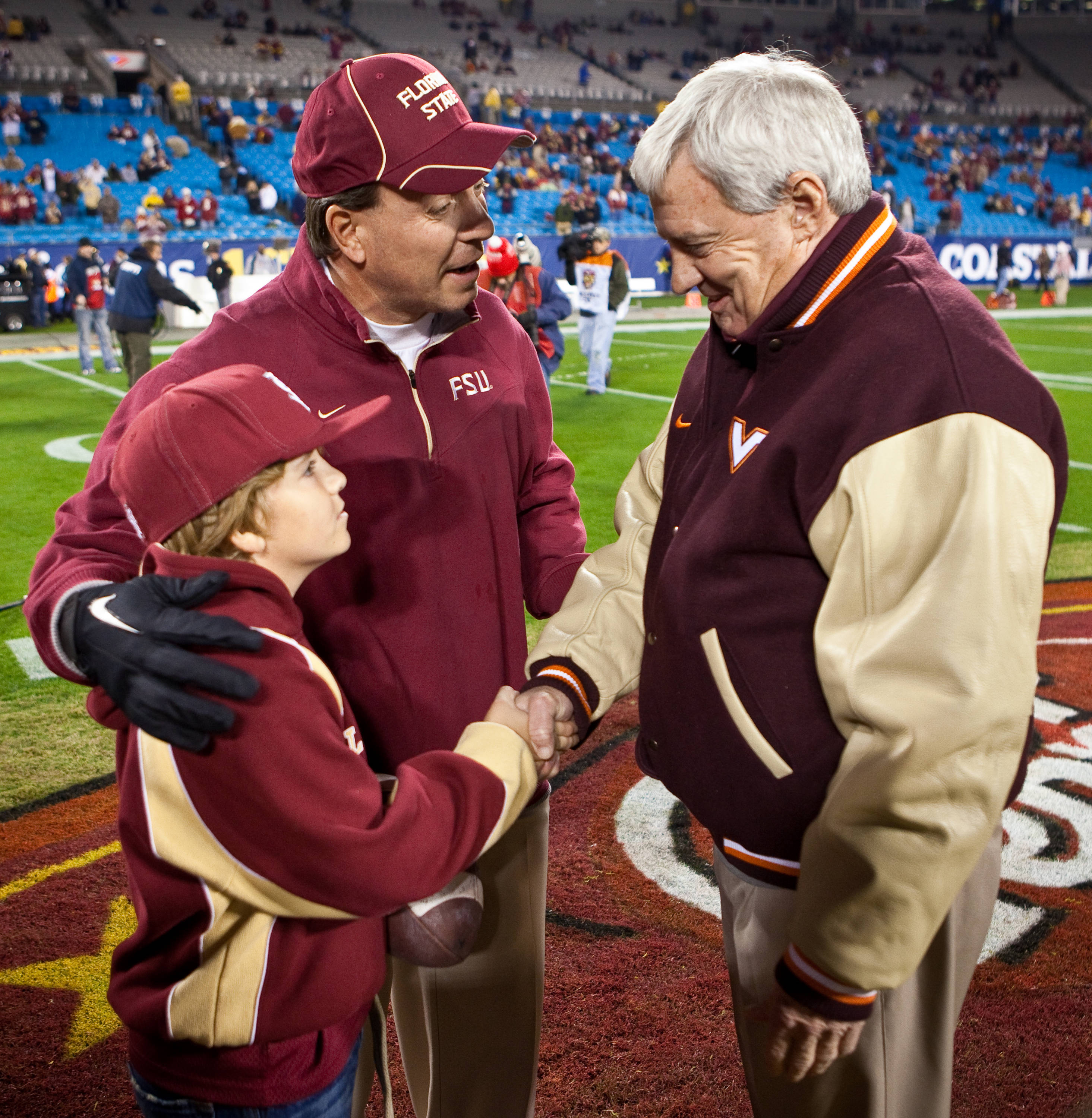 Jimbo and Trey Fisher meet Virginia Tech Head Coach Frank Beamer before the game