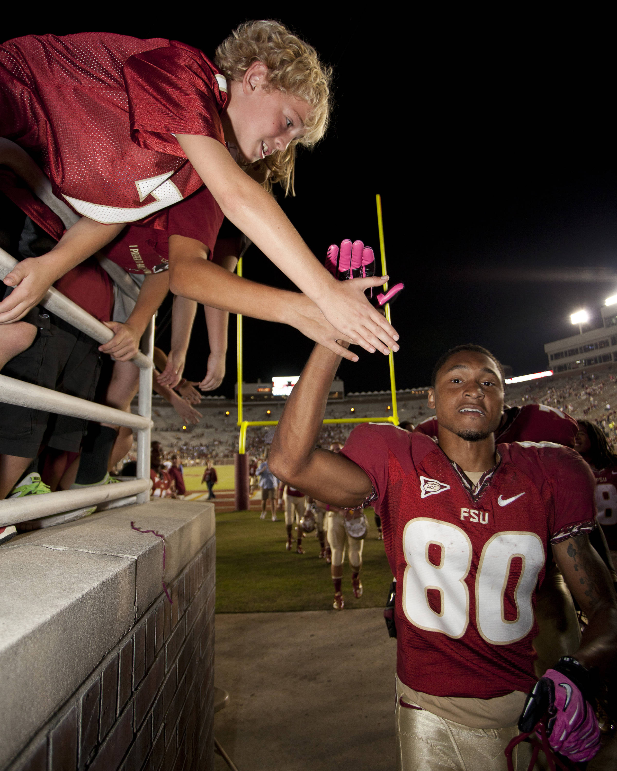 Rashad Greene (80) high-fives a young fan after the FSU vs Boston College football game on October 13, 2012 in Tallahassee, Fla.