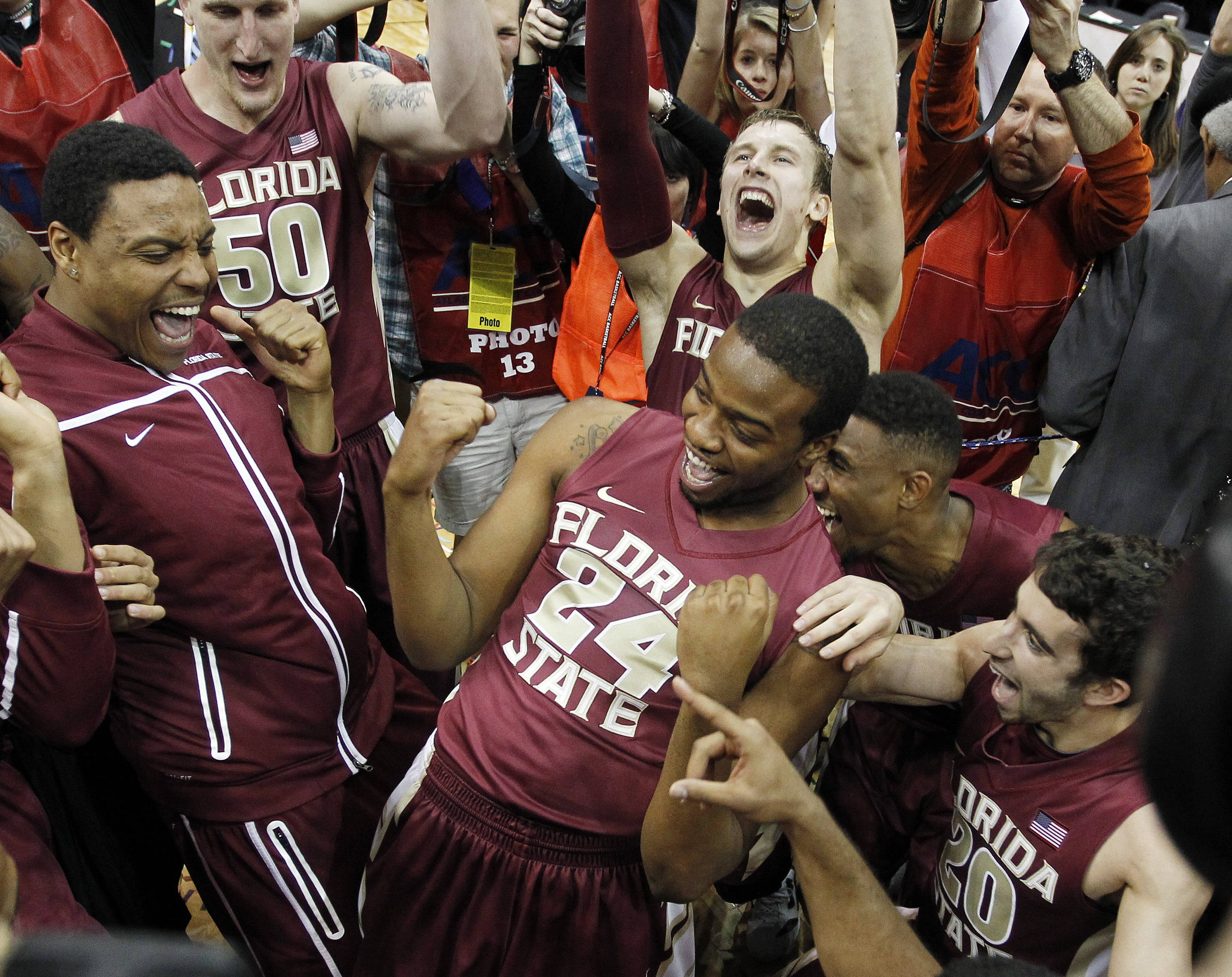 Antwan Space leads his teammates in a cheer. (AP Photo/John Bazemore)