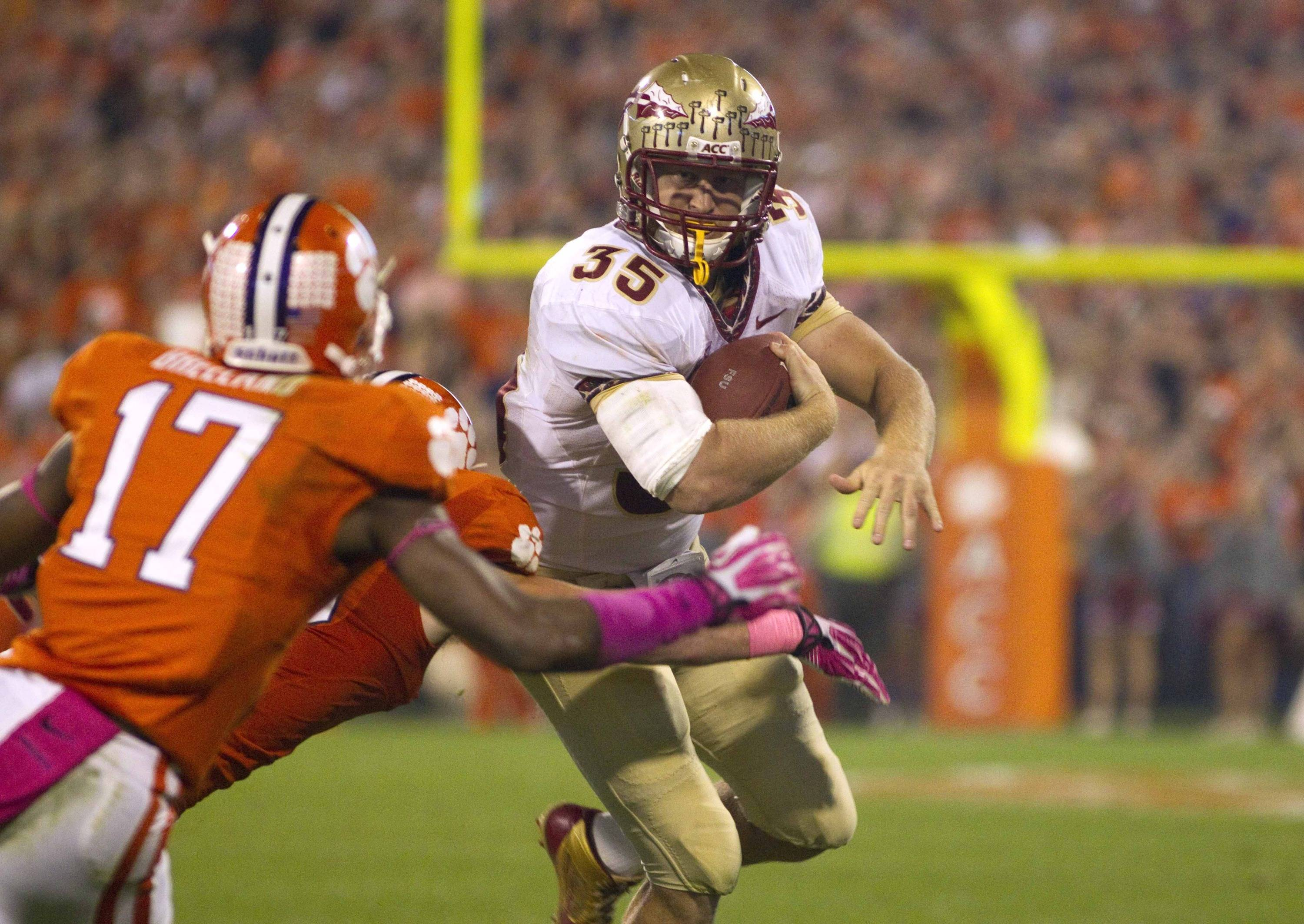 Florida State Seminoles tight end Nick O'Leary (35) carries the ball while being defended by Clemson Tigers defensive back Bashaud Breeland (17) during the first half at Clemson Memorial Stadium. (Joshua S. Kelly-USA TODAY Sports)