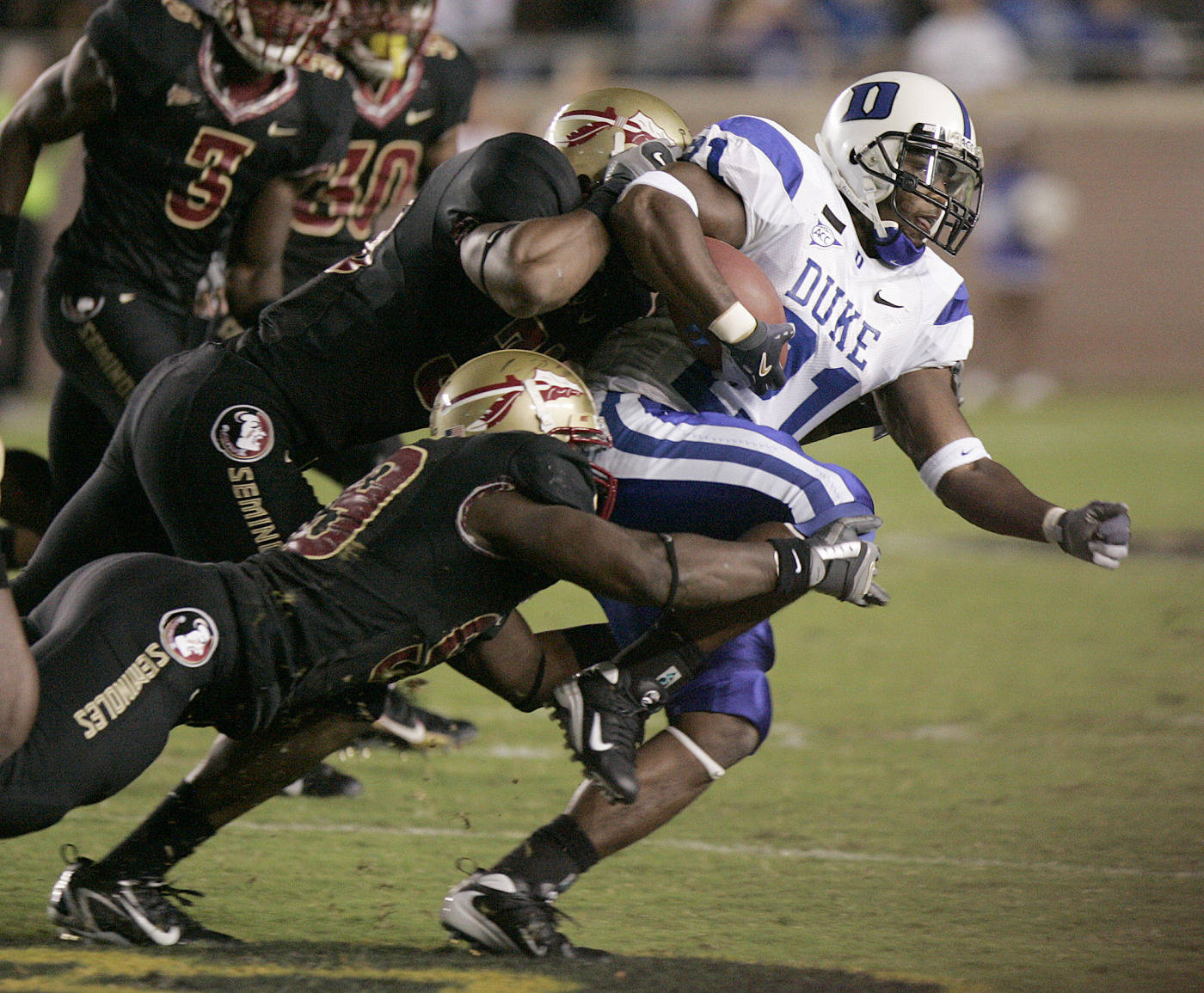 Duke's Re'quan Boyette tries to turn the corner on the Florida State defense. (AP Photo/Steve Cannon)