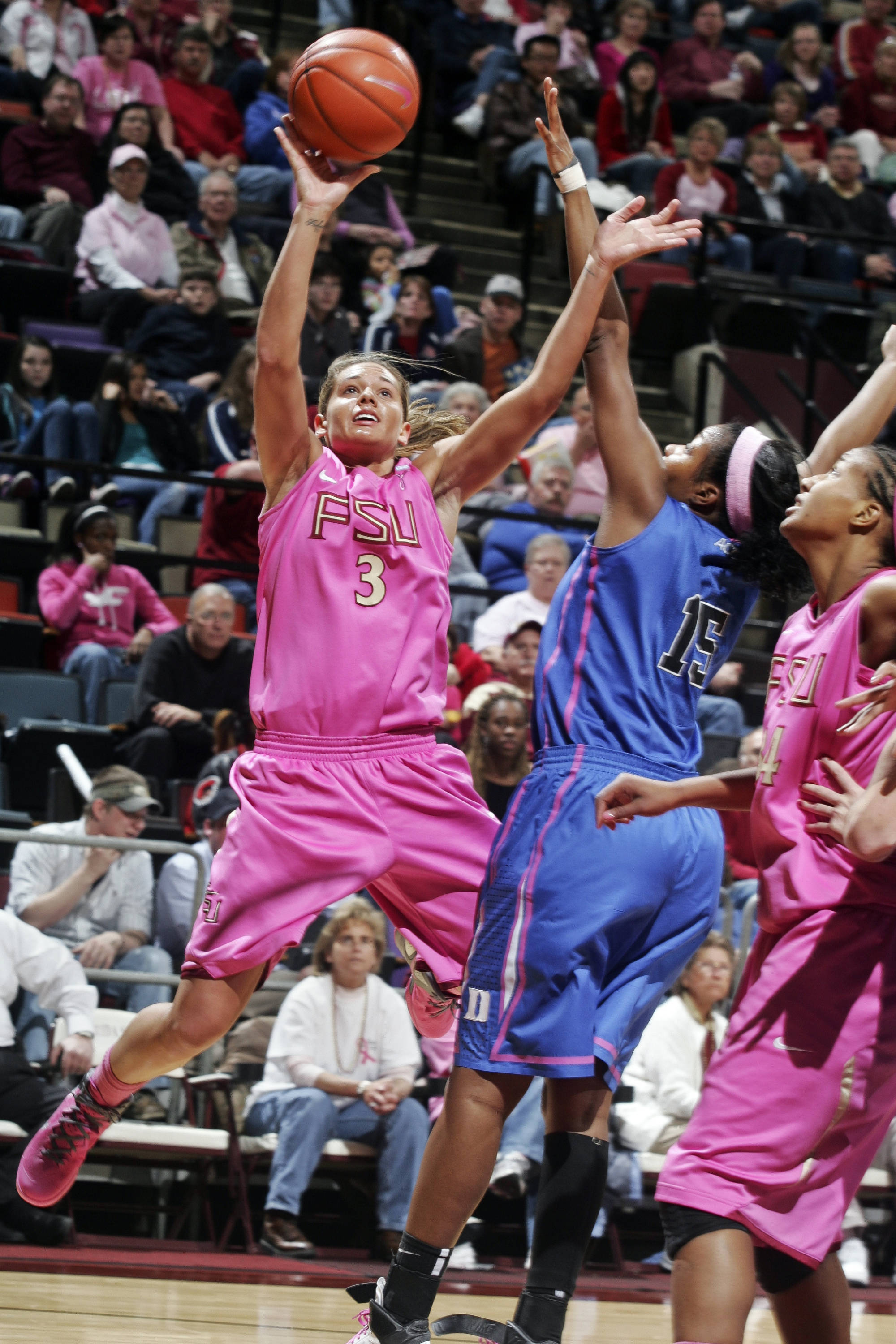 Florida State's Alexa Deluzio (3) shoots over Duke's Richa Jackson (15). (AP Photo/Phil Sears)