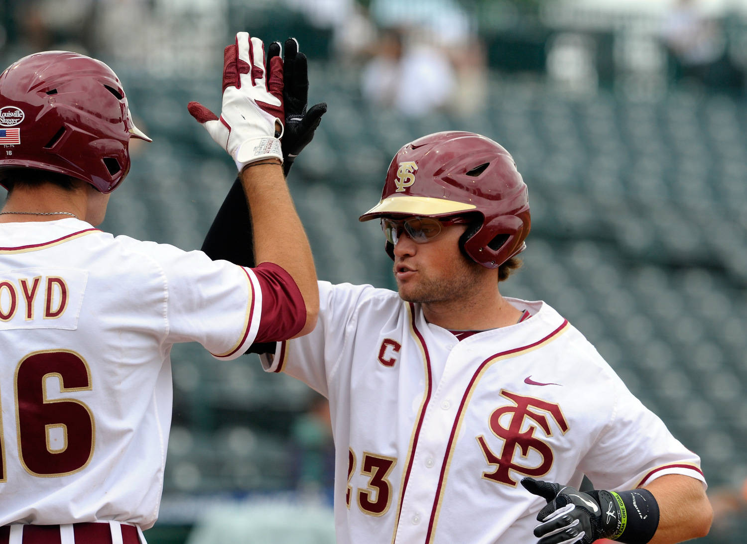Florida State's James Ramsey (23) is congratulated his homerun against Georgia Tech by Jayce Boyd (16) during the ACC Baseball Championship May 23, 2012 in Greensboro, N.C. (Photo by Sara D. Davis/theACC.com)
