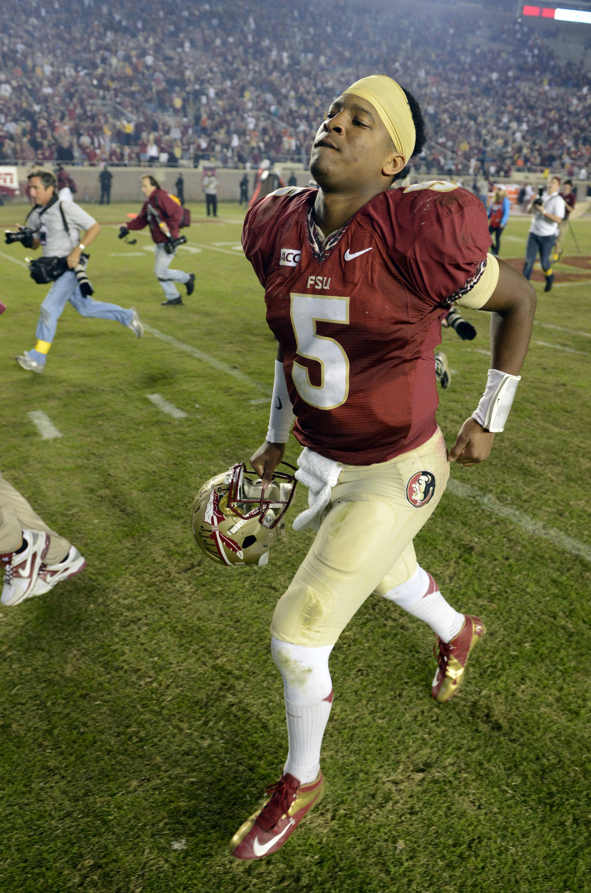 Florida State Seminoles quarterback Jameis Winston (5) runs off the field following the Seminoles 41-14 victory against the Miami Hurricanes at Doak Campbell Stadium. Mandatory Credit: John David Mercer-USA TODAY Sports