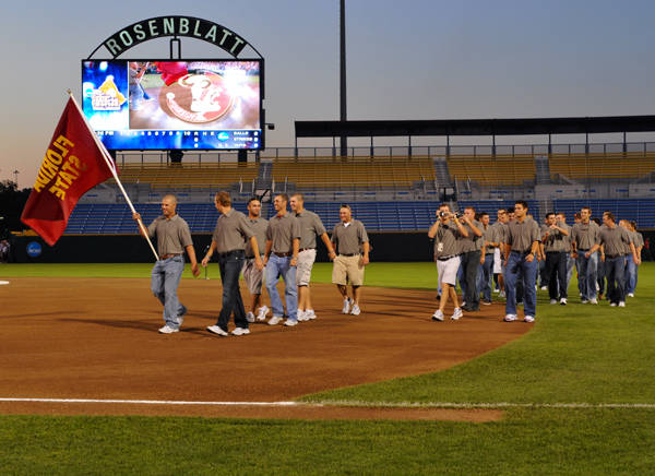 The Seminoles enter the field during the opening ceremonies inside Rosenblatt Stadium