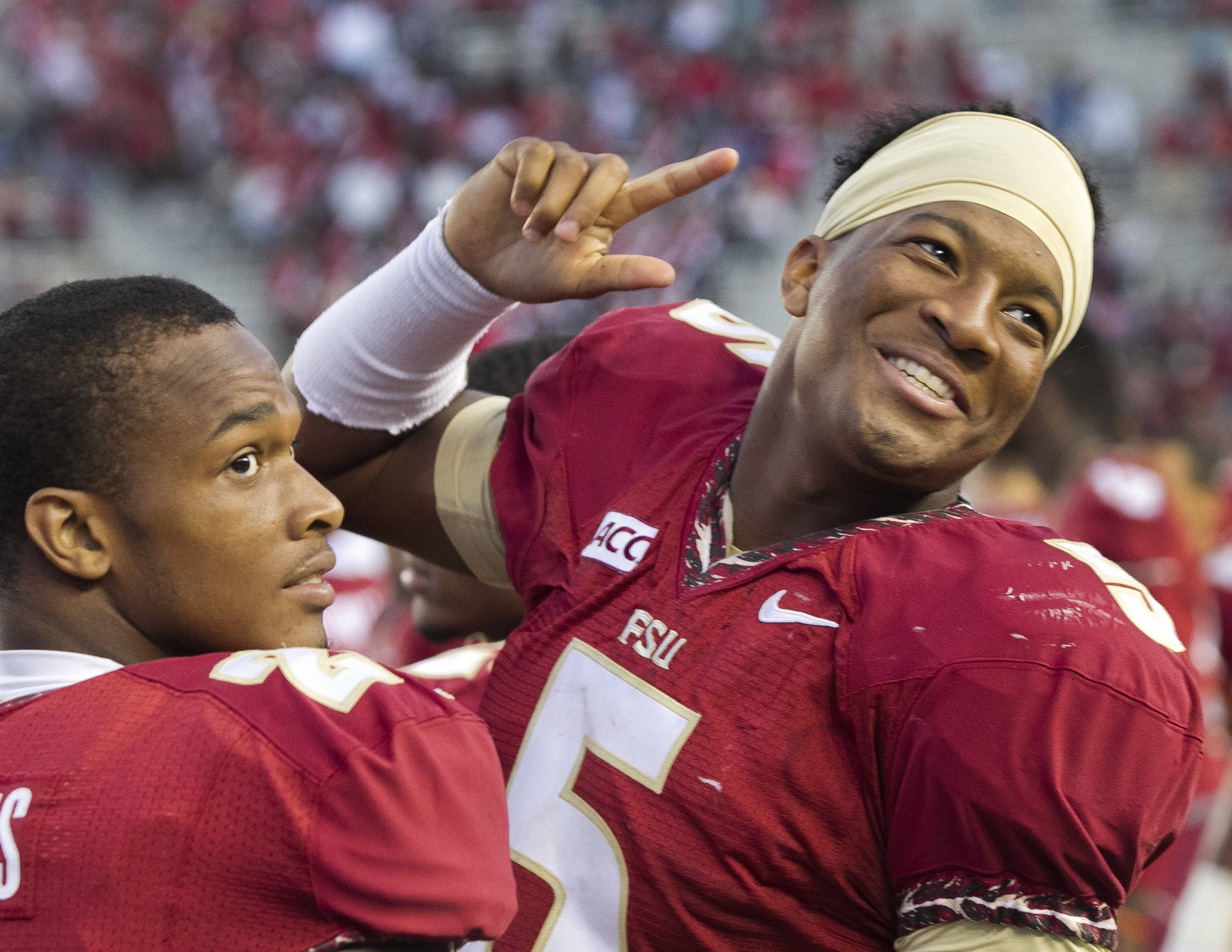 Jameis Winston (5) acknowledging a fan, FSU vs NC State,  10-26-13, (Photo by Steve Musco)