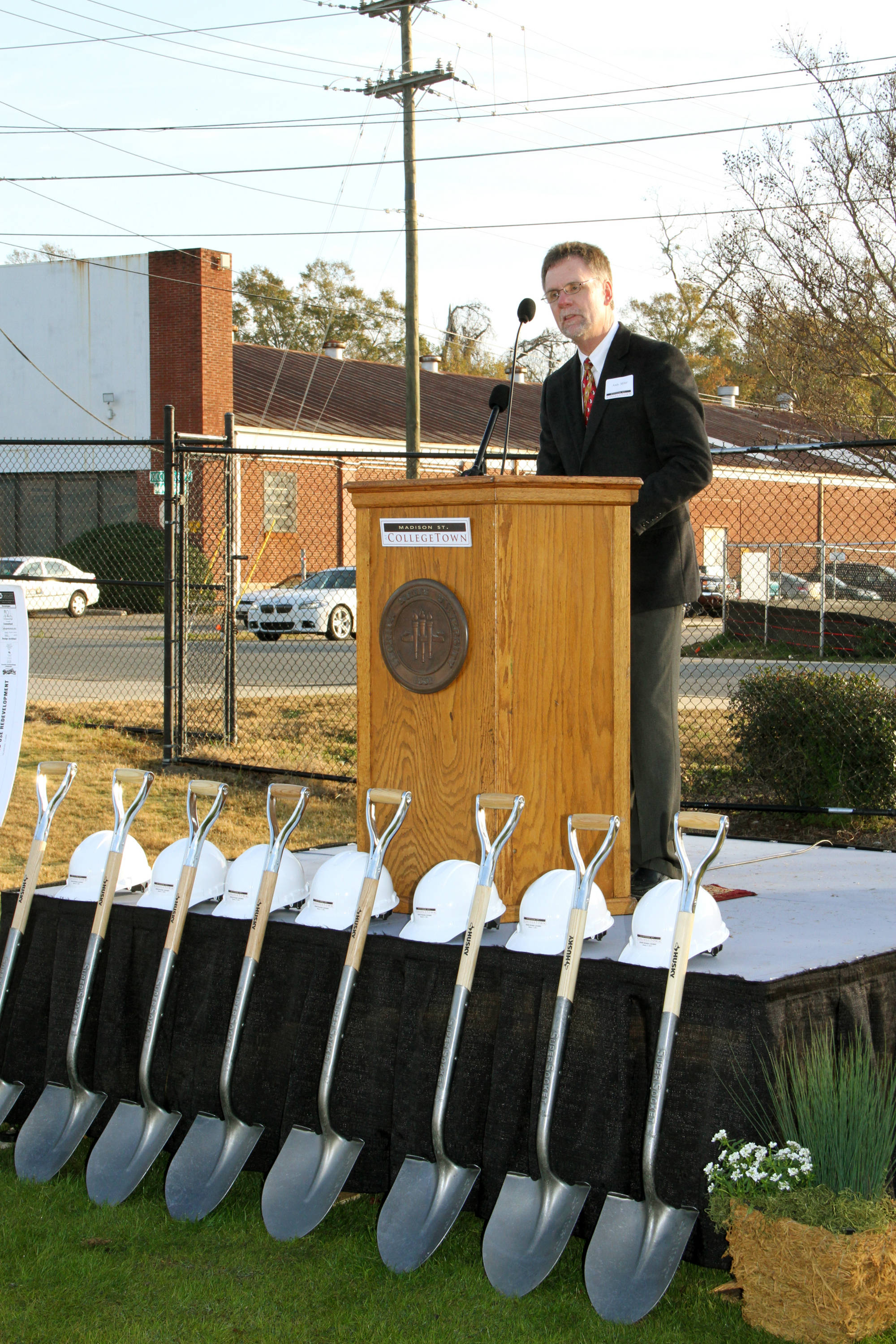 CollegeTown Groundbreaking: Press Conference with remarks held on the old intramural fields which is right across Woodward Avenue from CollegeTown. Groundbreaking was held on site.#$%^#$%^Andy Miller, President of Seminole Boosters is at the podium.
