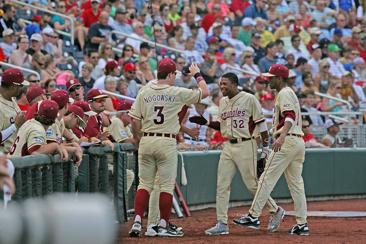 Sherman Johnson greeted back at the dugout with John Nogowski and Giovanny Alfonzo