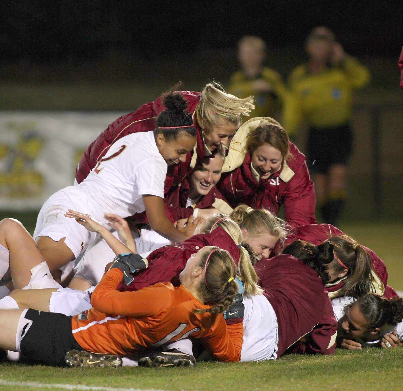 Pile on!  The Seminole soccer team celebrates Jessica Price's golden goal in a 2-1 victory over Texas A&M in the third round of the NCAA Tournament.