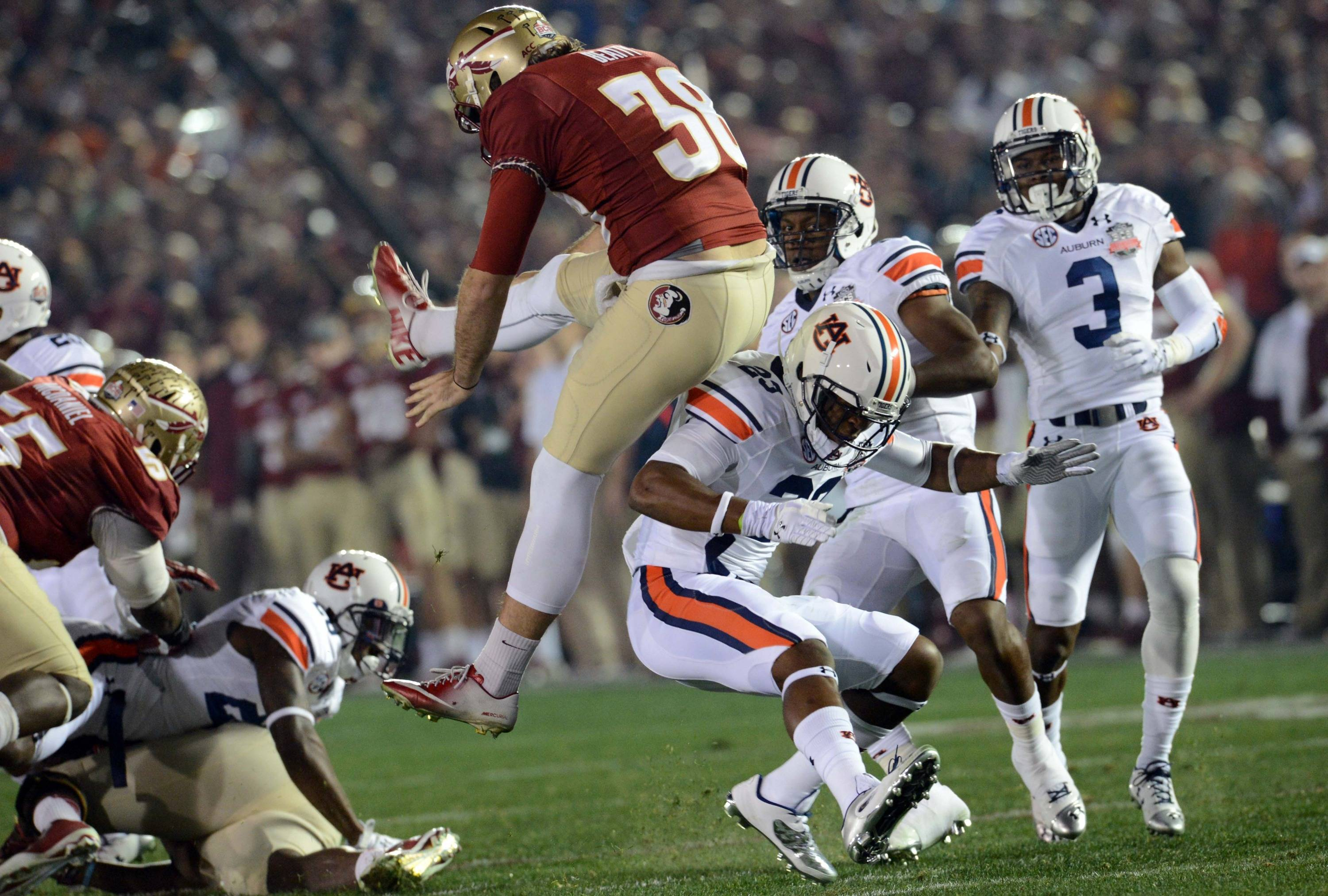Jan 6, 2014; Pasadena, CA, USA; Auburn Tigers running back Johnathan Ford (23) is called for roughing the punter against Florida State Seminoles punter Cason Beatty (38) during the first half of the 2014 BCS National Championship game at the Rose Bowl.  Mandatory Credit: Jayne Kamin-Oncea-USA TODAY Sports