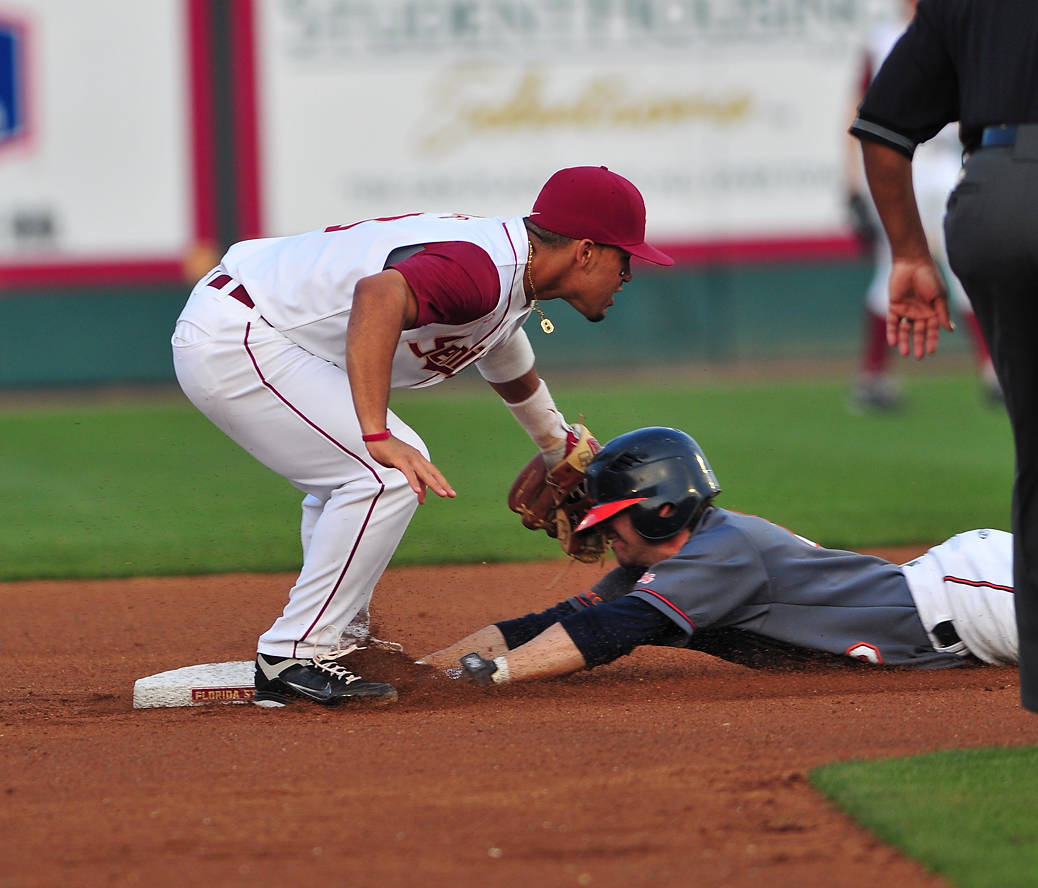 Devon Travis makes the tag at second