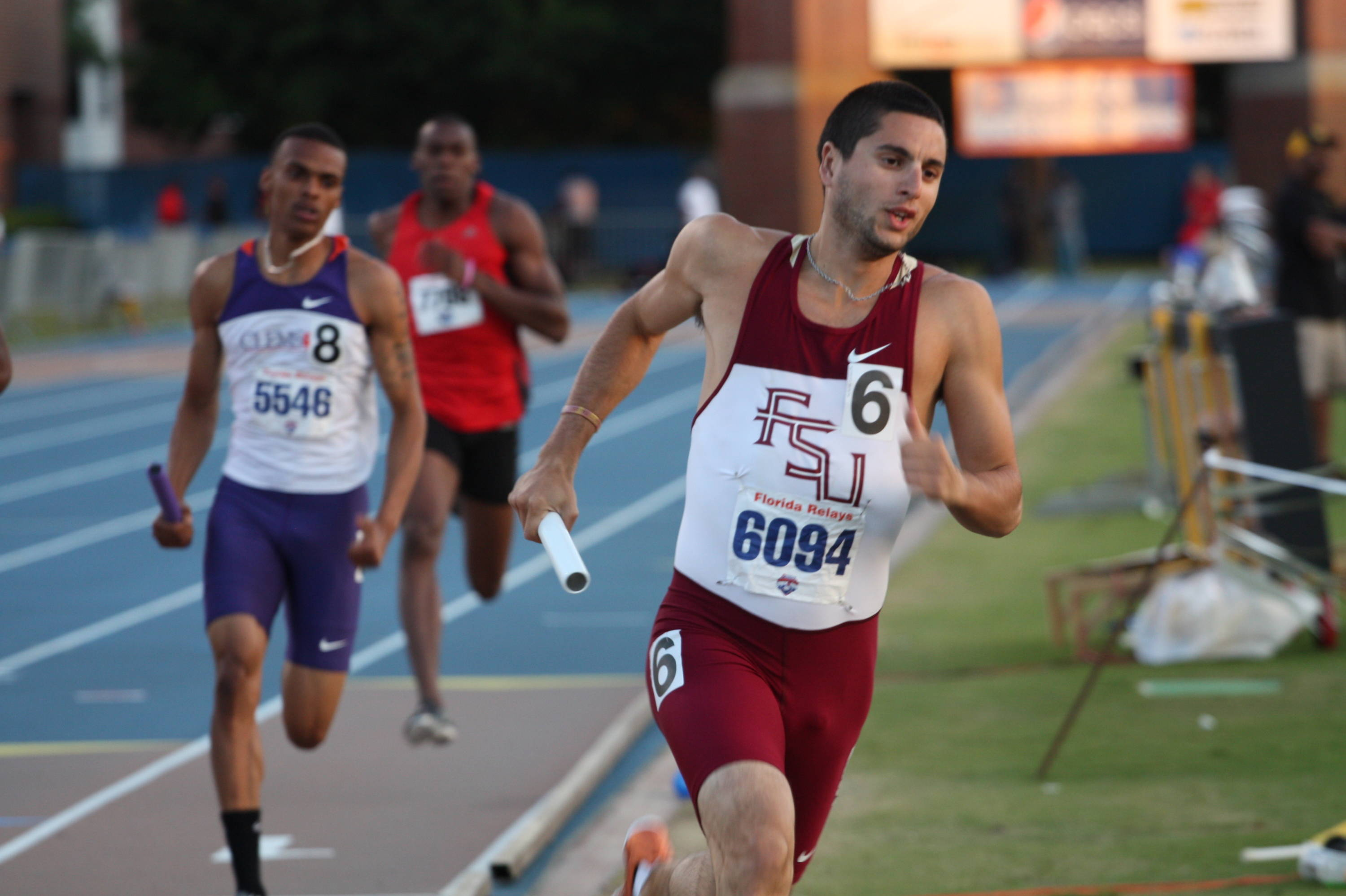 Pablo Navarrete leans into the turn during the 4x400 relay at the Florida Relays