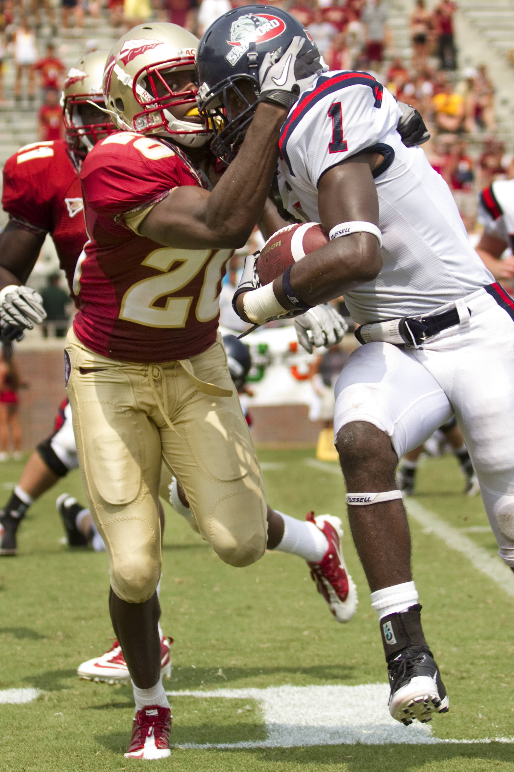 Lamarcus Joyner (20) pulls the ball carrier for Samford out of bounds in the last quarter.