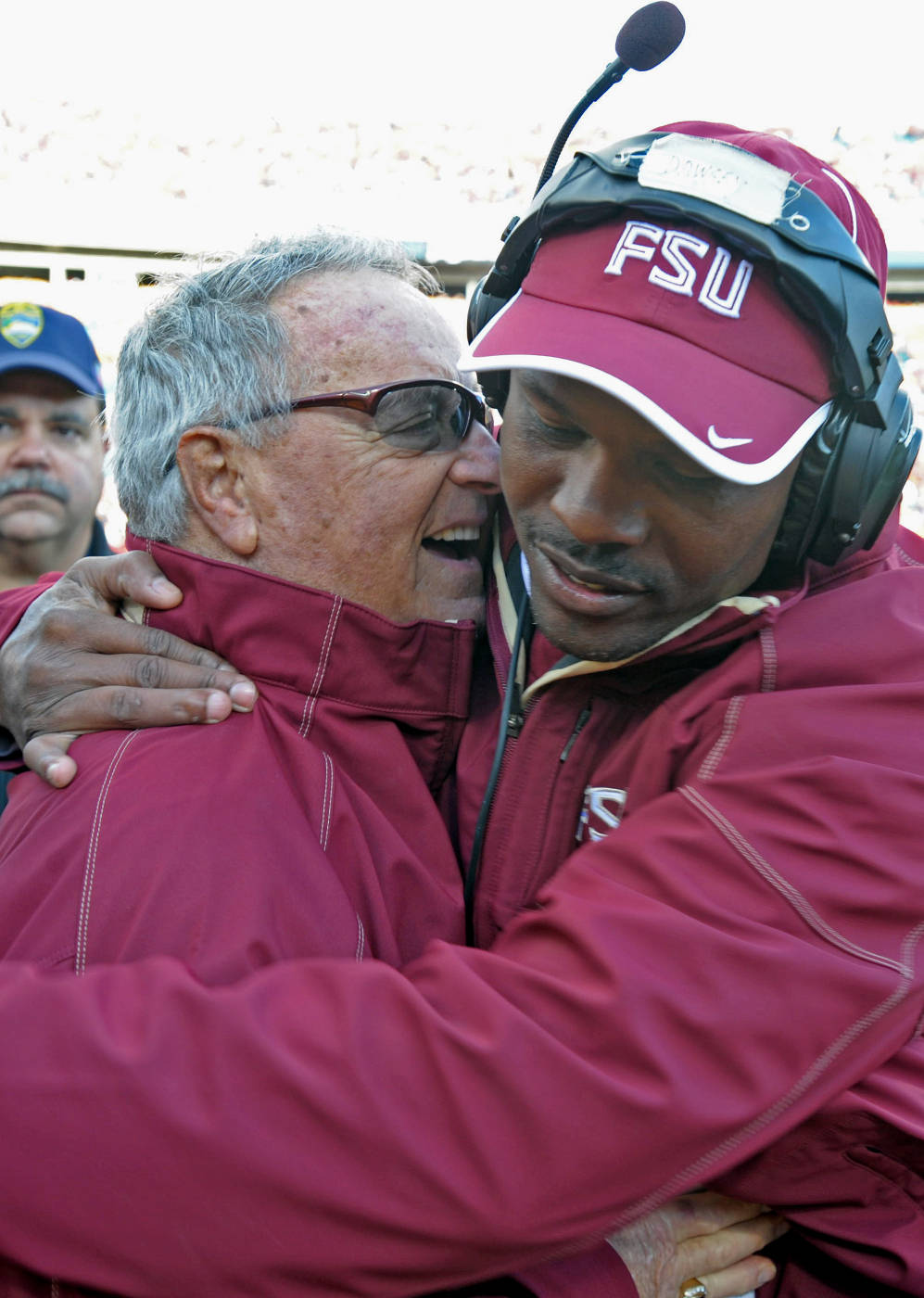 Bobby Bowden and Lawrence Dawsey share a hug on the sideline