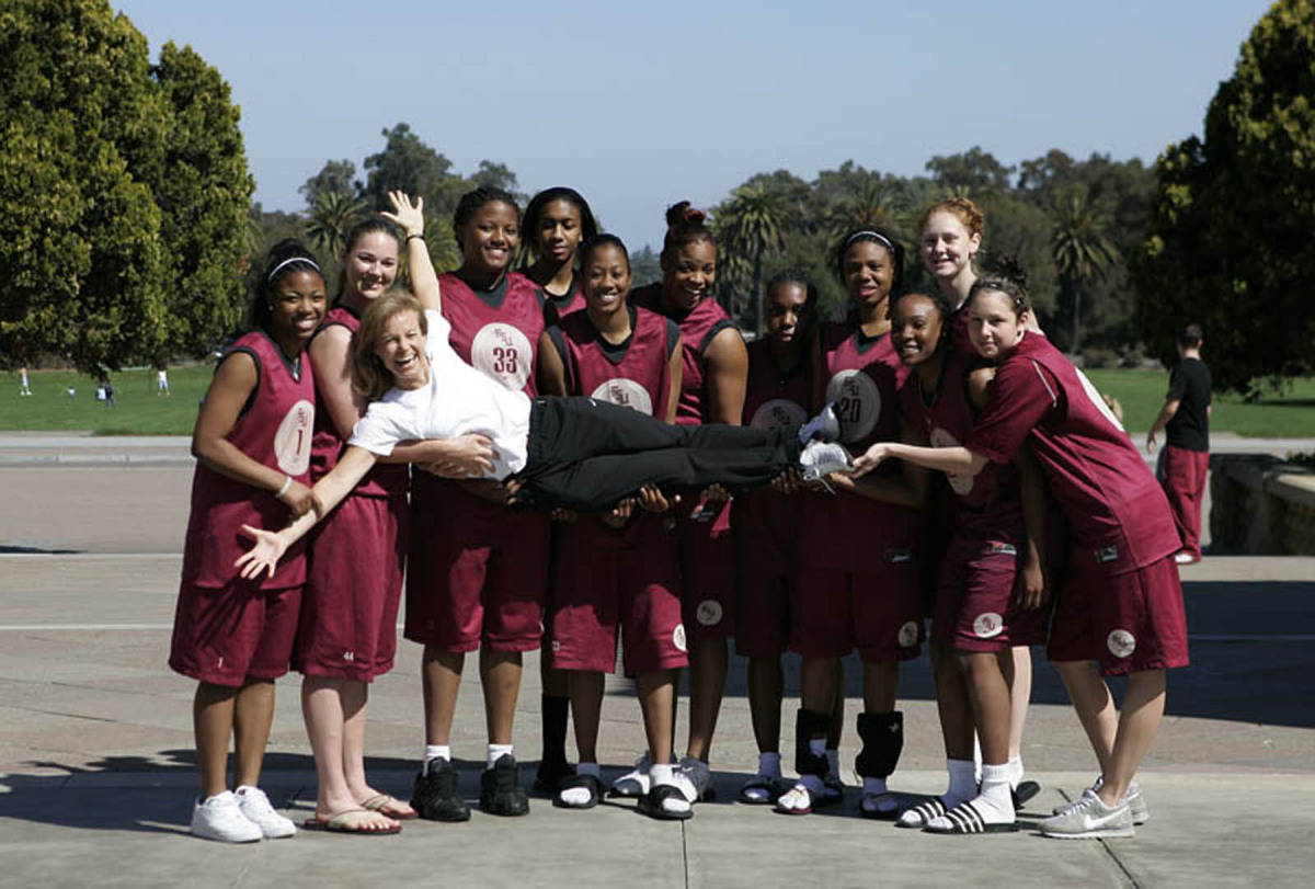 The Seminoles carry Coach Sue for a photo.