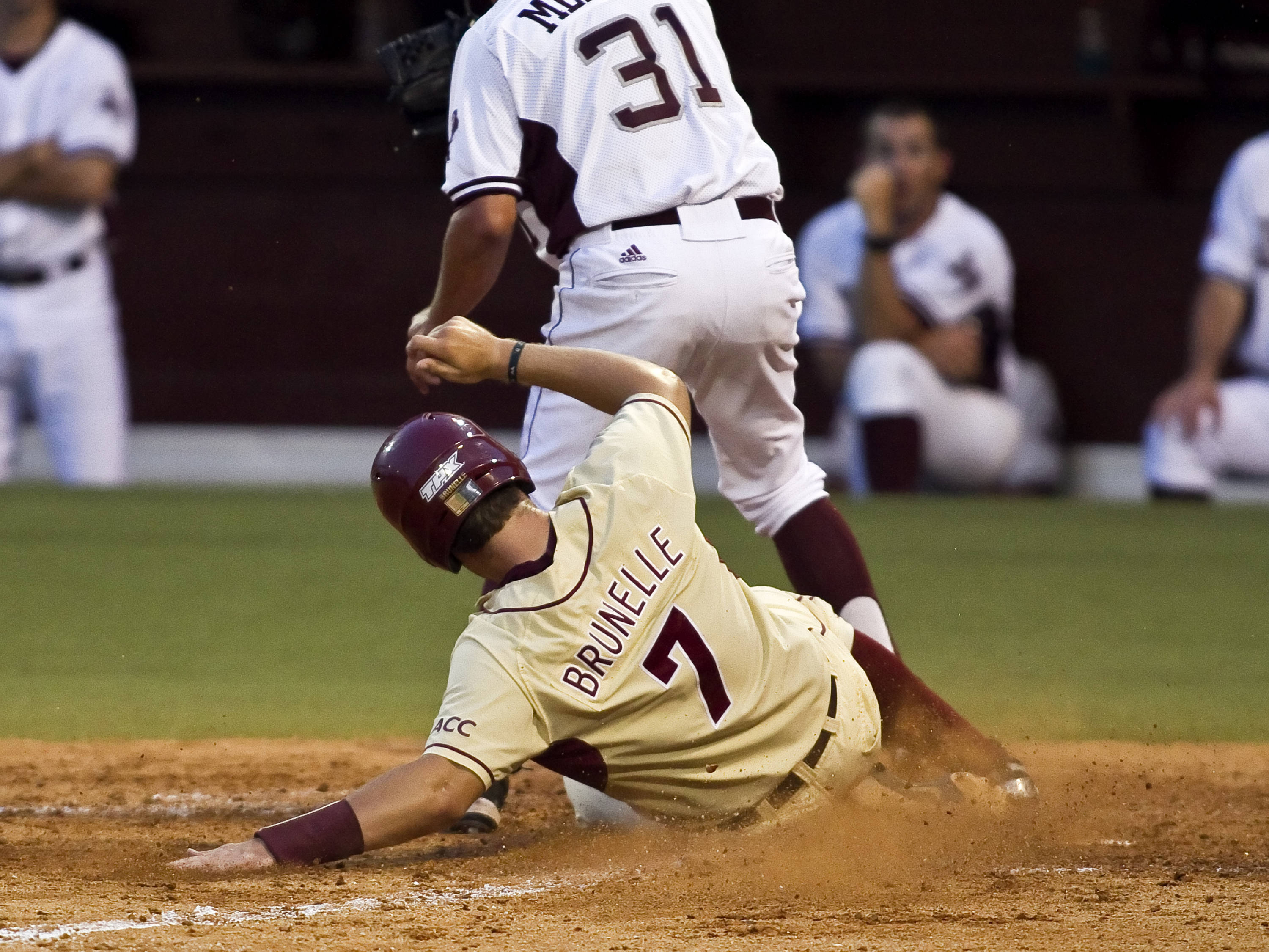 Parker Brunelle (7) scoring on a wild pitch in the 8th inning
