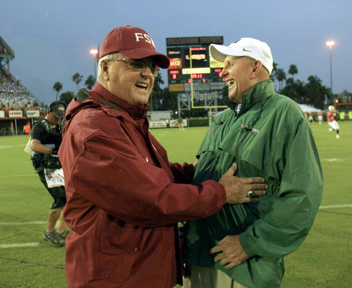 Florida State head coach Bobby Bowden, left, and Miami head coach Larry Coker share a laugh before a game Monday, Sept. 4, 2006 at the Orange Bowl in Miami. (AP Photo/Luis M. Alvarez)